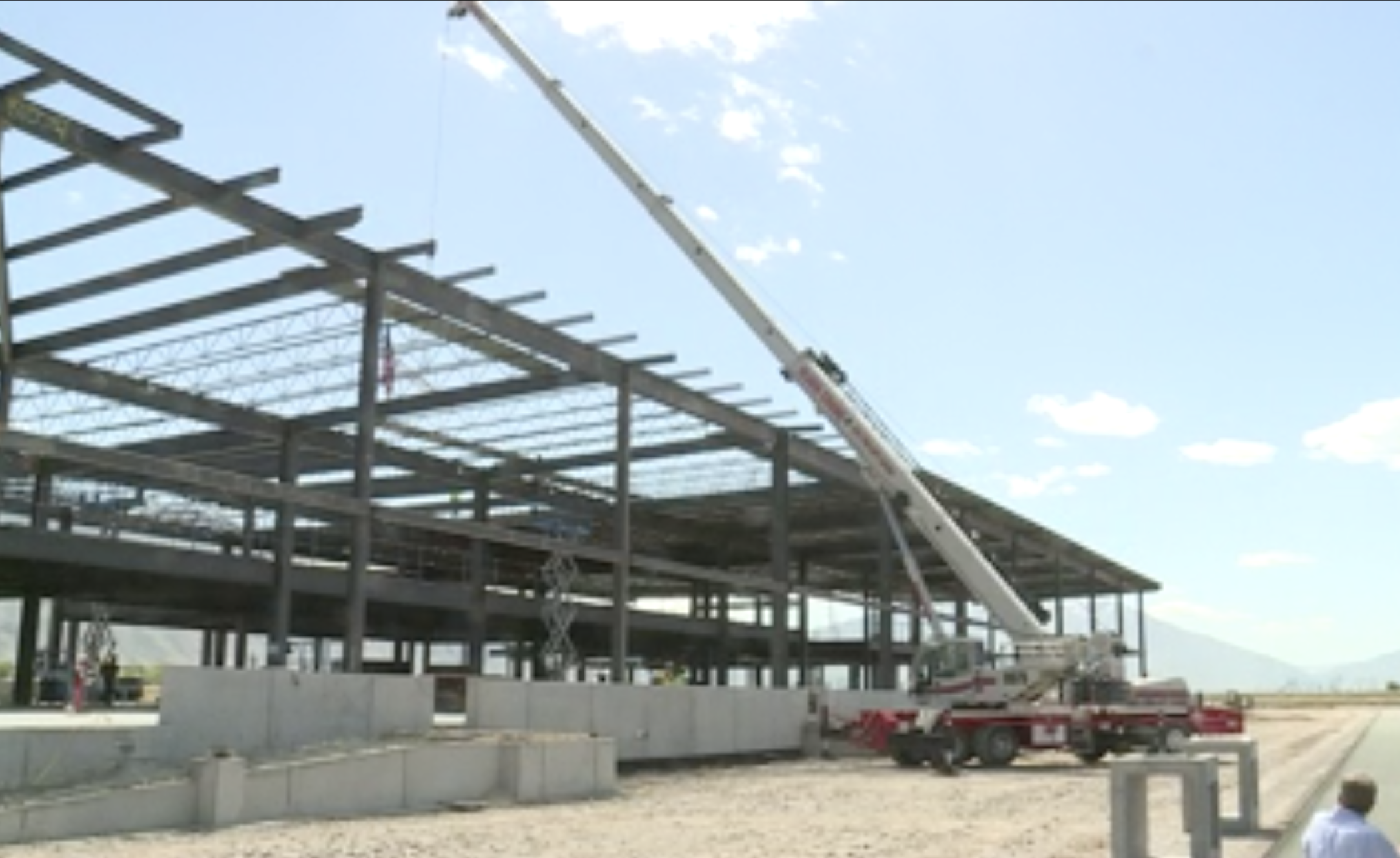 A crane hoists the highest beam of the new Provo Municipal Airport terminal into place on Thursday, May 20, 2021.