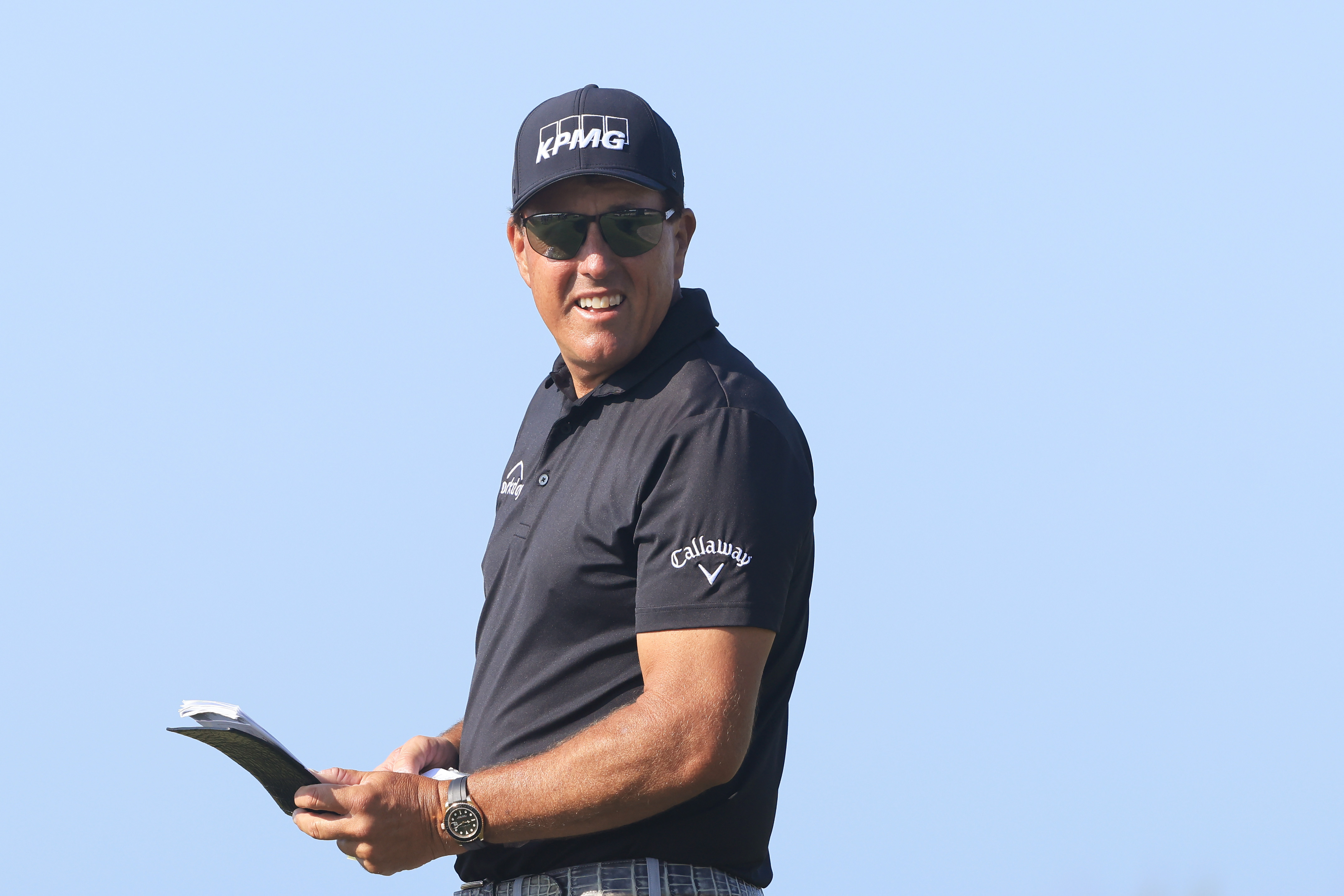 Phil Mickelson of the United States checks his yardage book on the 15th tee during the second round of the 2021 PGA Championship at Kiawah Island Resort's Ocean Course on May 21, 2021 in Kiawah Island, South Carolina.