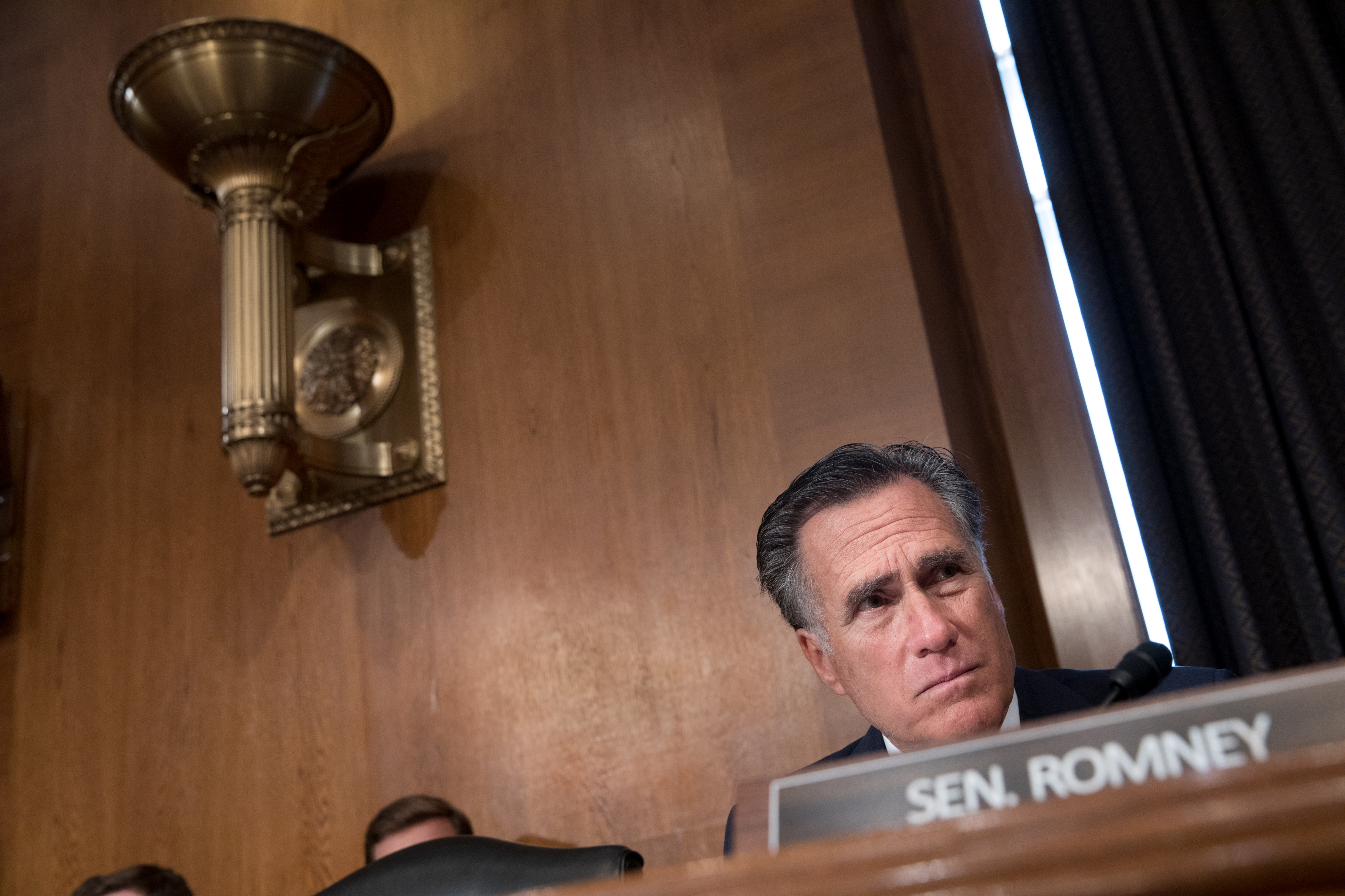 Sen. Mitt Romney listens during the HELP Hearing: Implementing the 21st Century Cures Act on Capitol Hill in Washington.