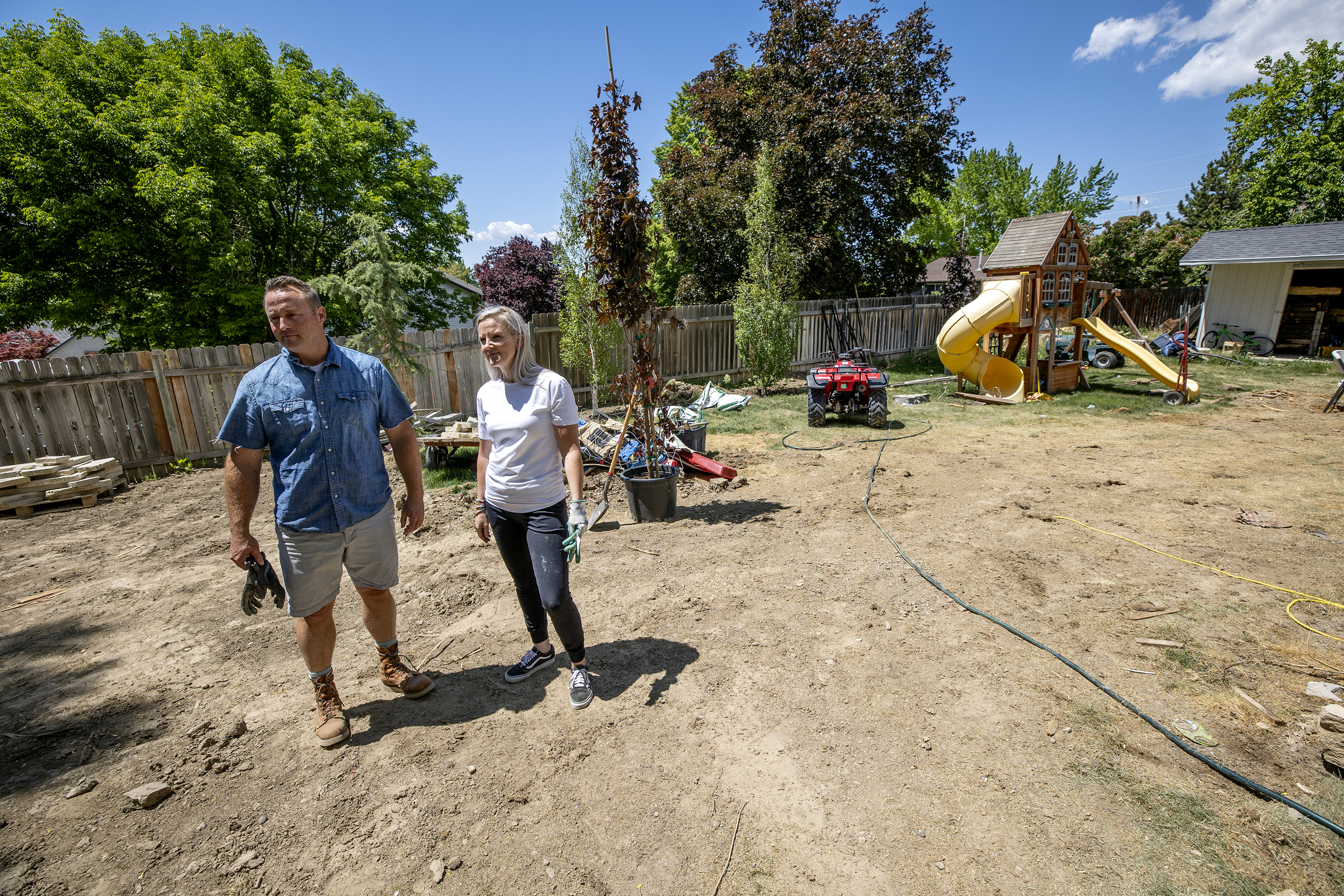 Cody Jolley, left, and his wife, Julia, stand in the backyard of their home in Pleasant Grove.