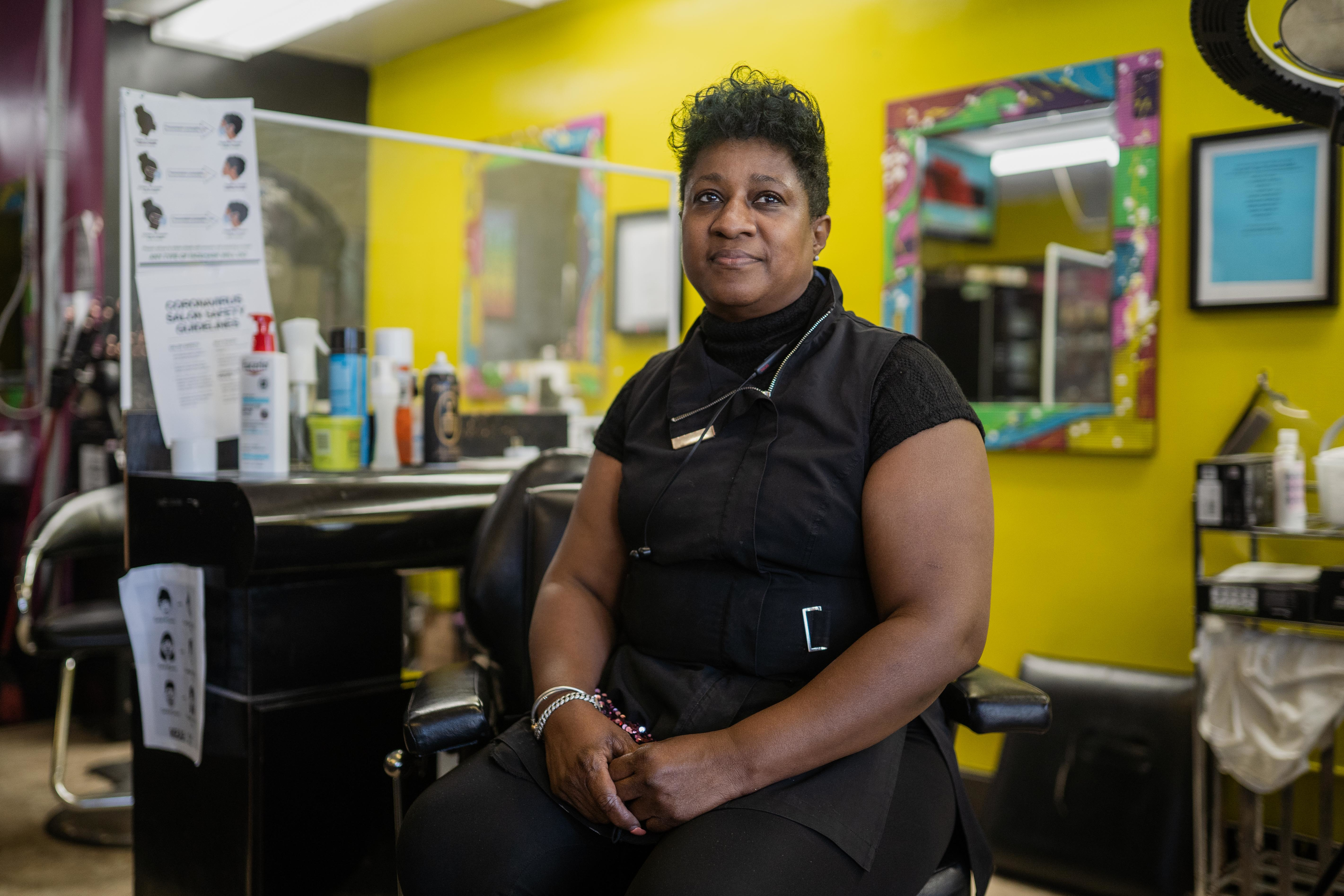 Tess Porter, owner of Tess's Place Style Shop, which was looted after the killing of George Floyd in Minneapolis in 2020, stands inside her salon in the West Englewood neighborhood a year later.