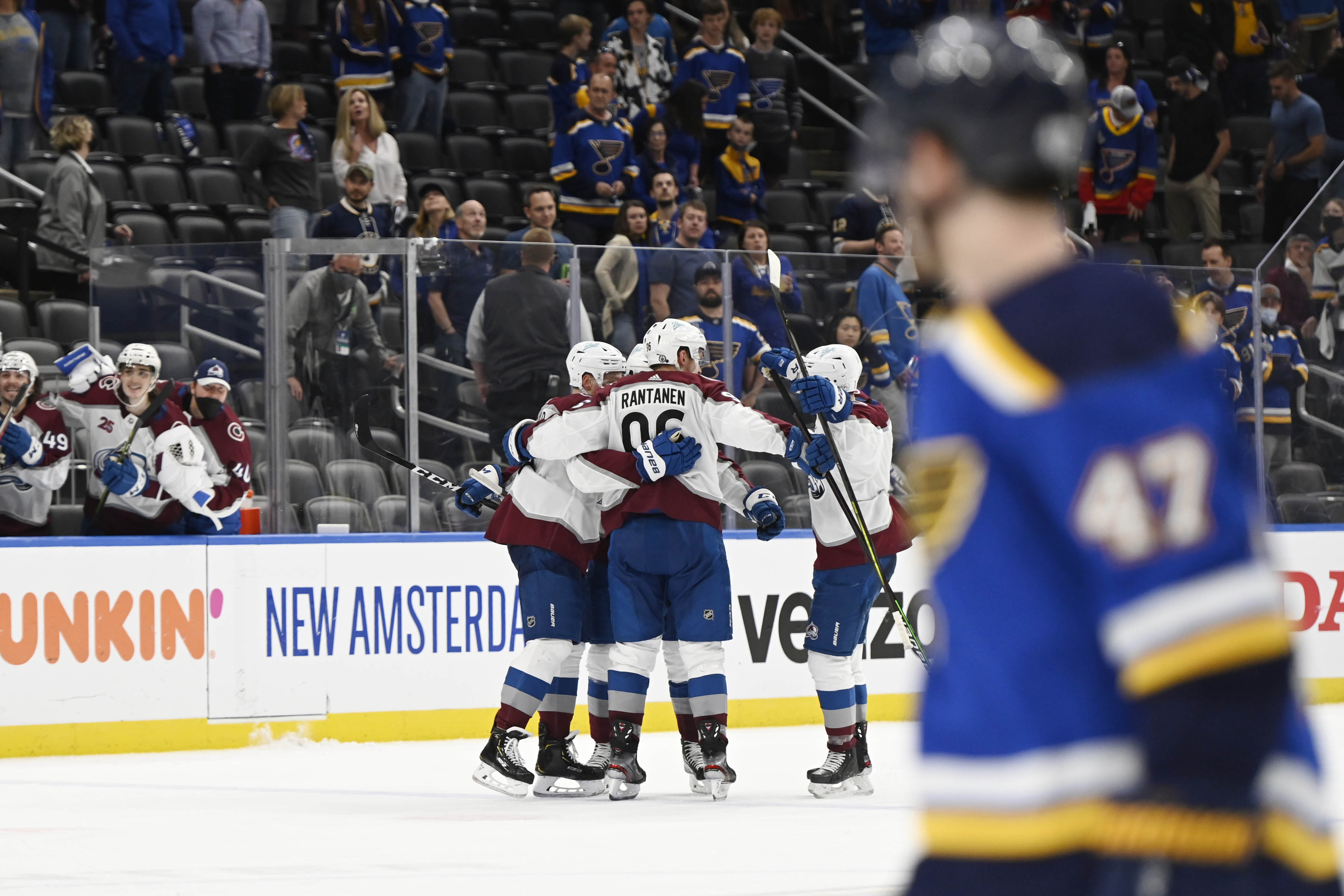 Colorado Avalanche center Nathan MacKinnon (29) is congratulated by teammates after scoring an empty net goal against the St. Louis Blues in the third period in game four of the first round of the 2021 Stanley Cup Playoffs at Enterprise Center.