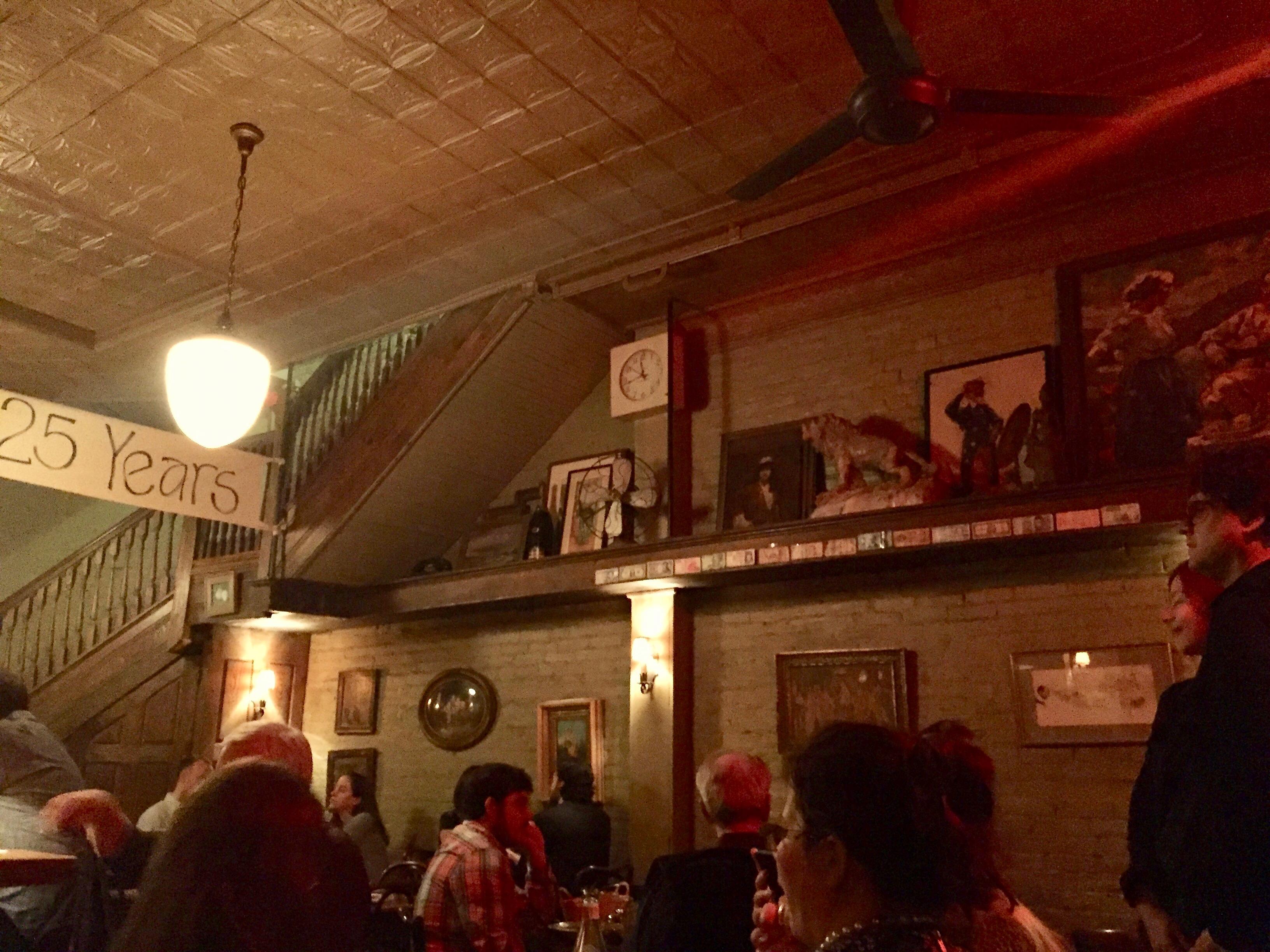 inside of a dimly lit hardware store turned into italian restaurant