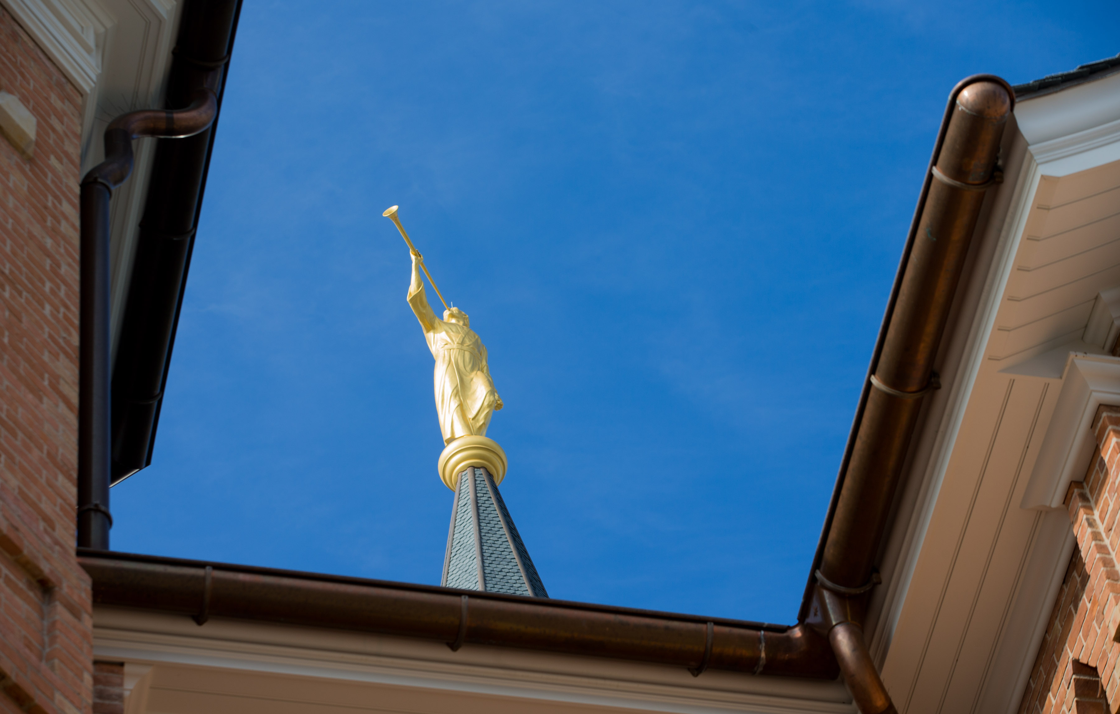 The statue of the Angel Moroni is shown between towers atop the Provo City Temple Monday, Jan. 11, 2016.