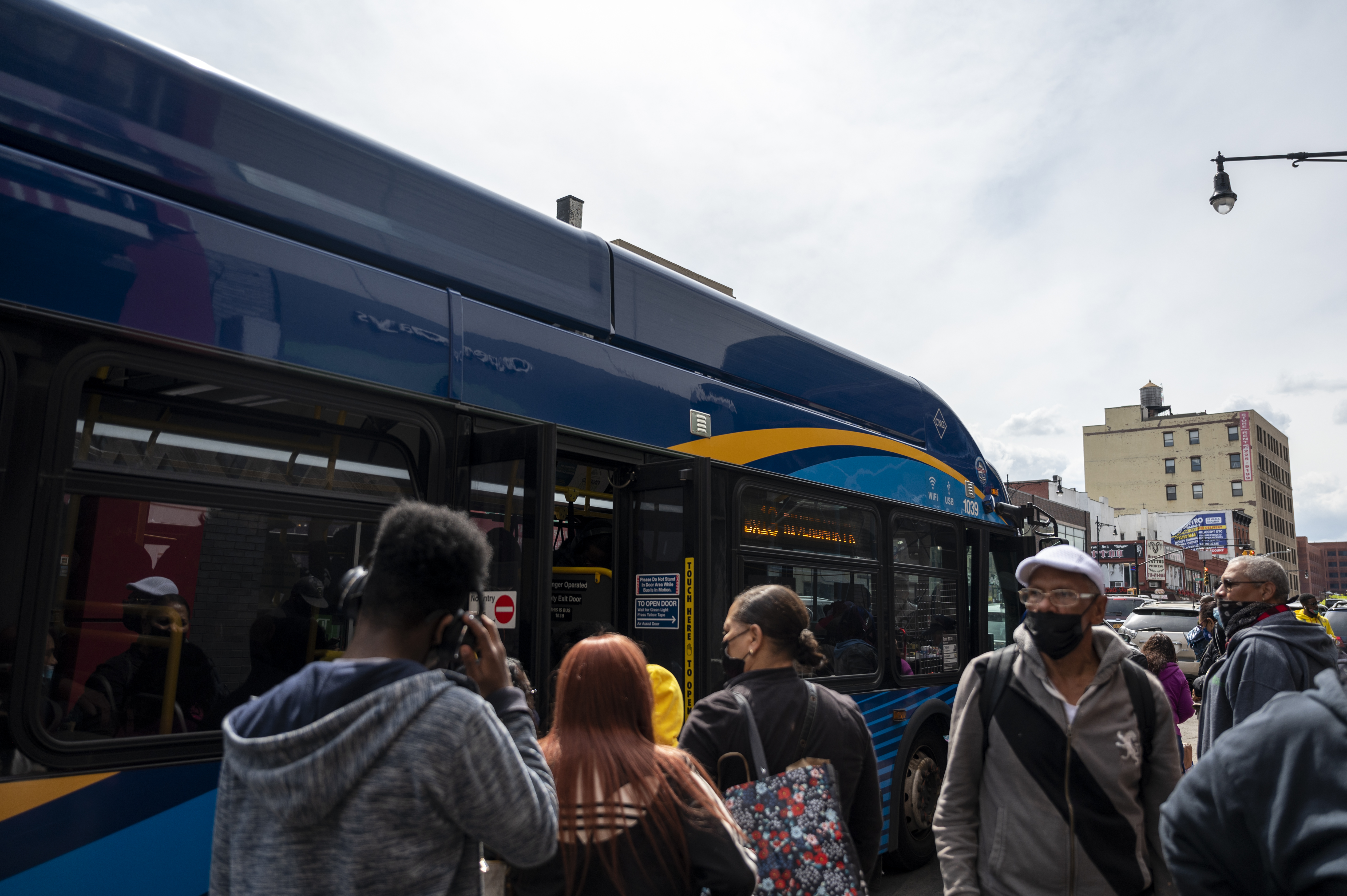 A crowd of commuters waiting to board the bus at The Hub on Friday, May. 7, 2021.