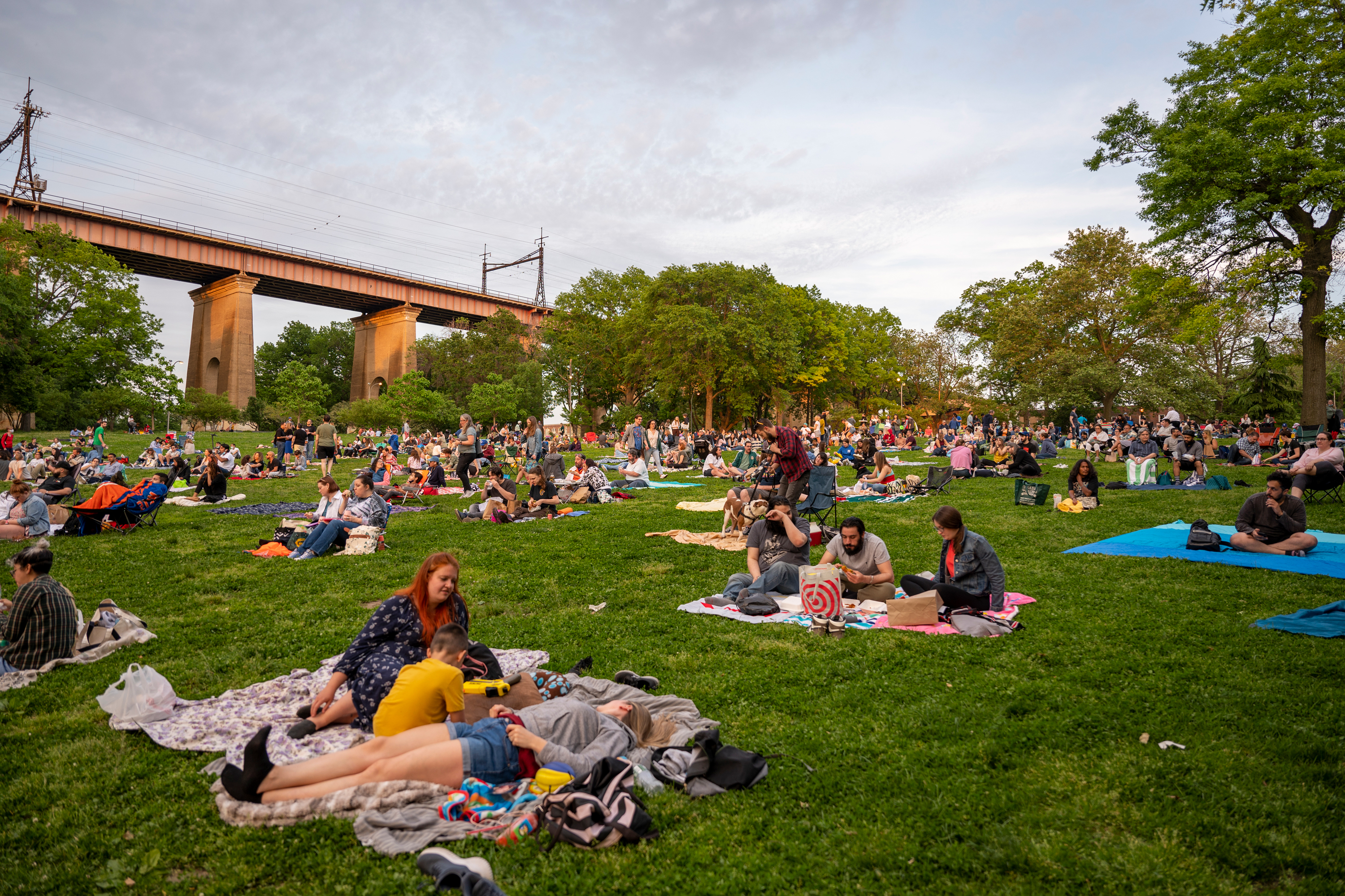 People gather in Astoria Park ahead of an outdoor movie, May 21, 2021.