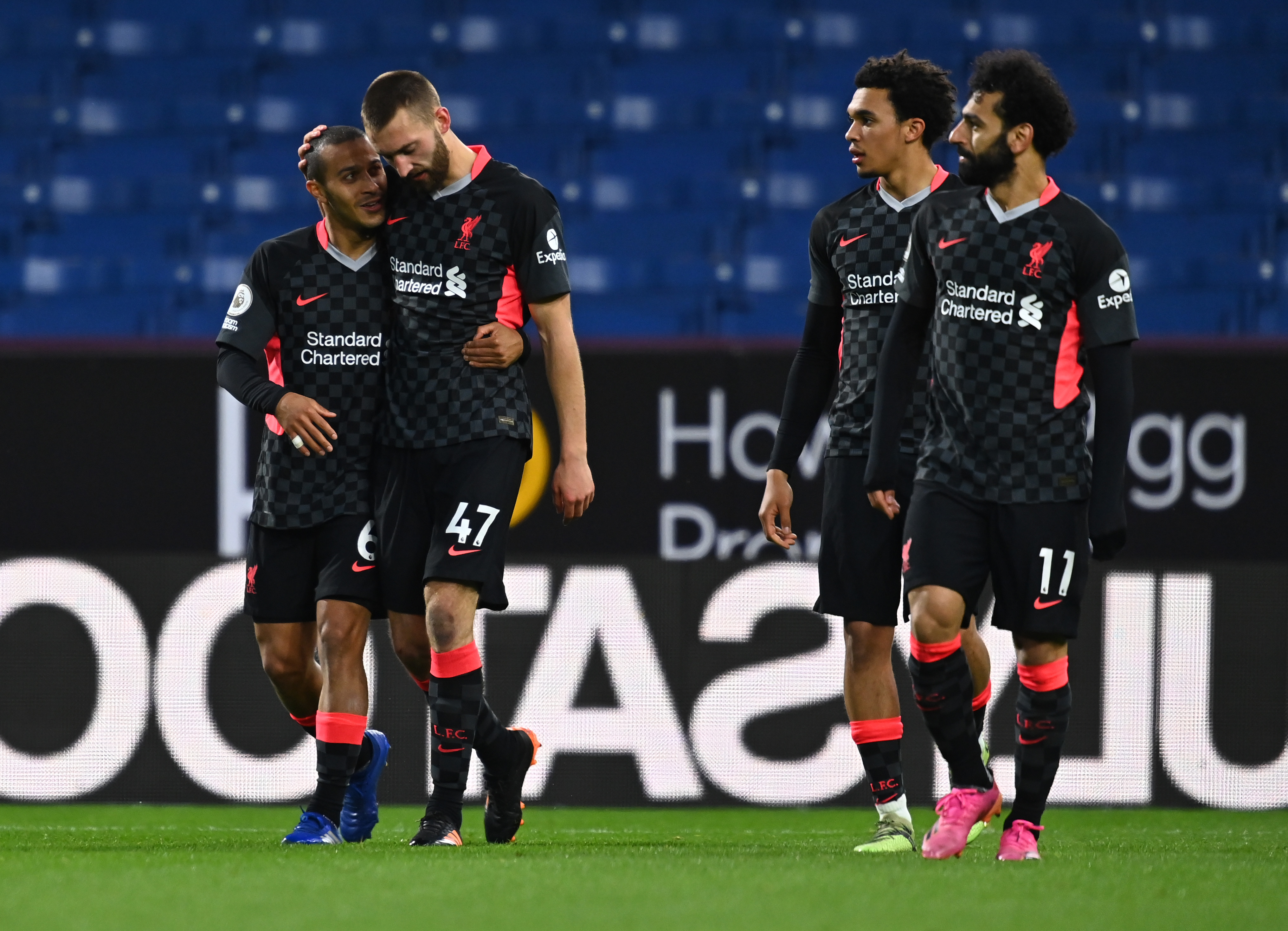 Nathaniel Phillips celebrates with Thiago - Liverpool - Premier League