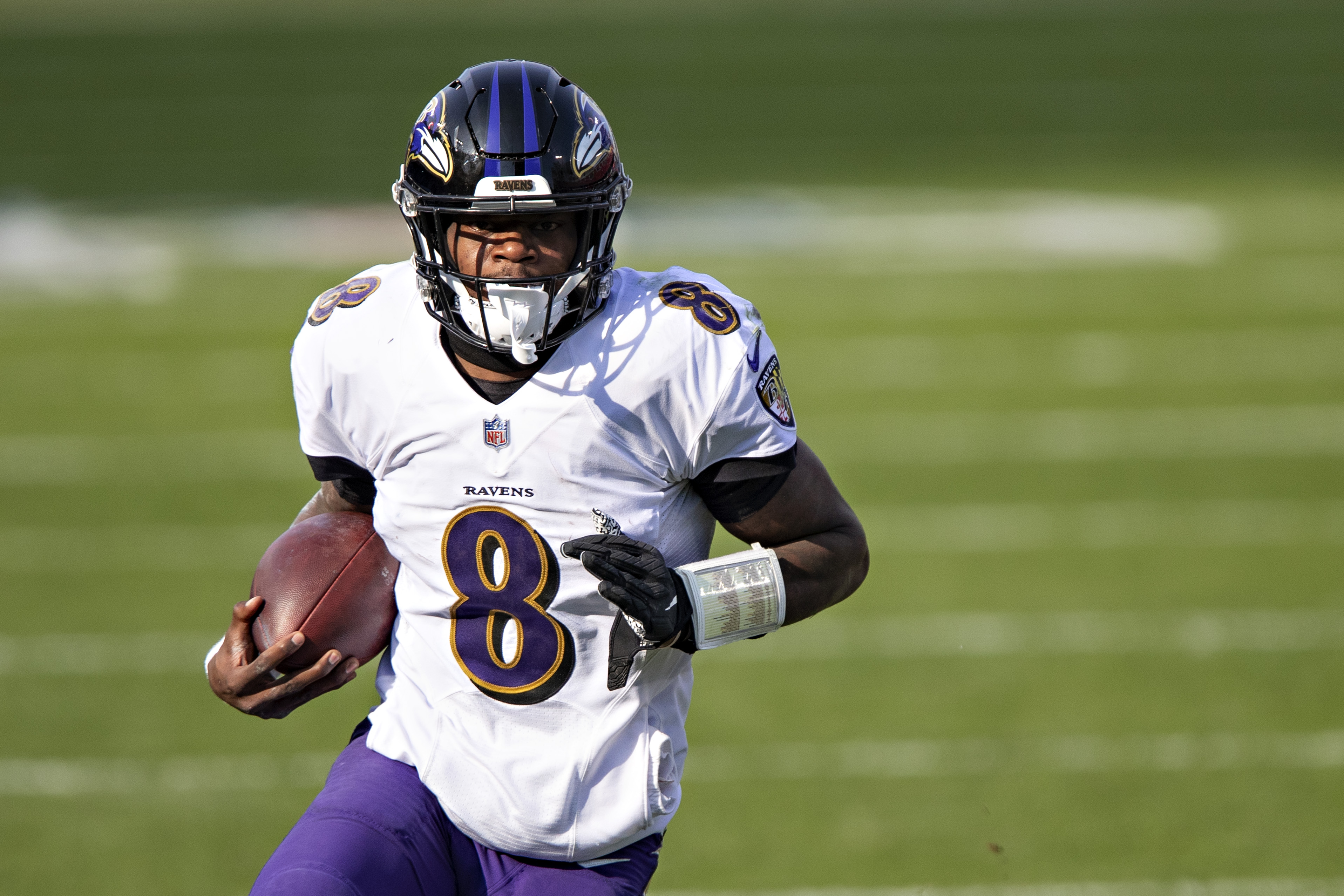 Quarterback Lamar Jackson #8 of the Baltimore Ravens runs the ball during their AFC Wild Card Playoff game against the Tennessee Titans at Nissan Stadium on January 10, 2021 in Nashville, Tennessee.