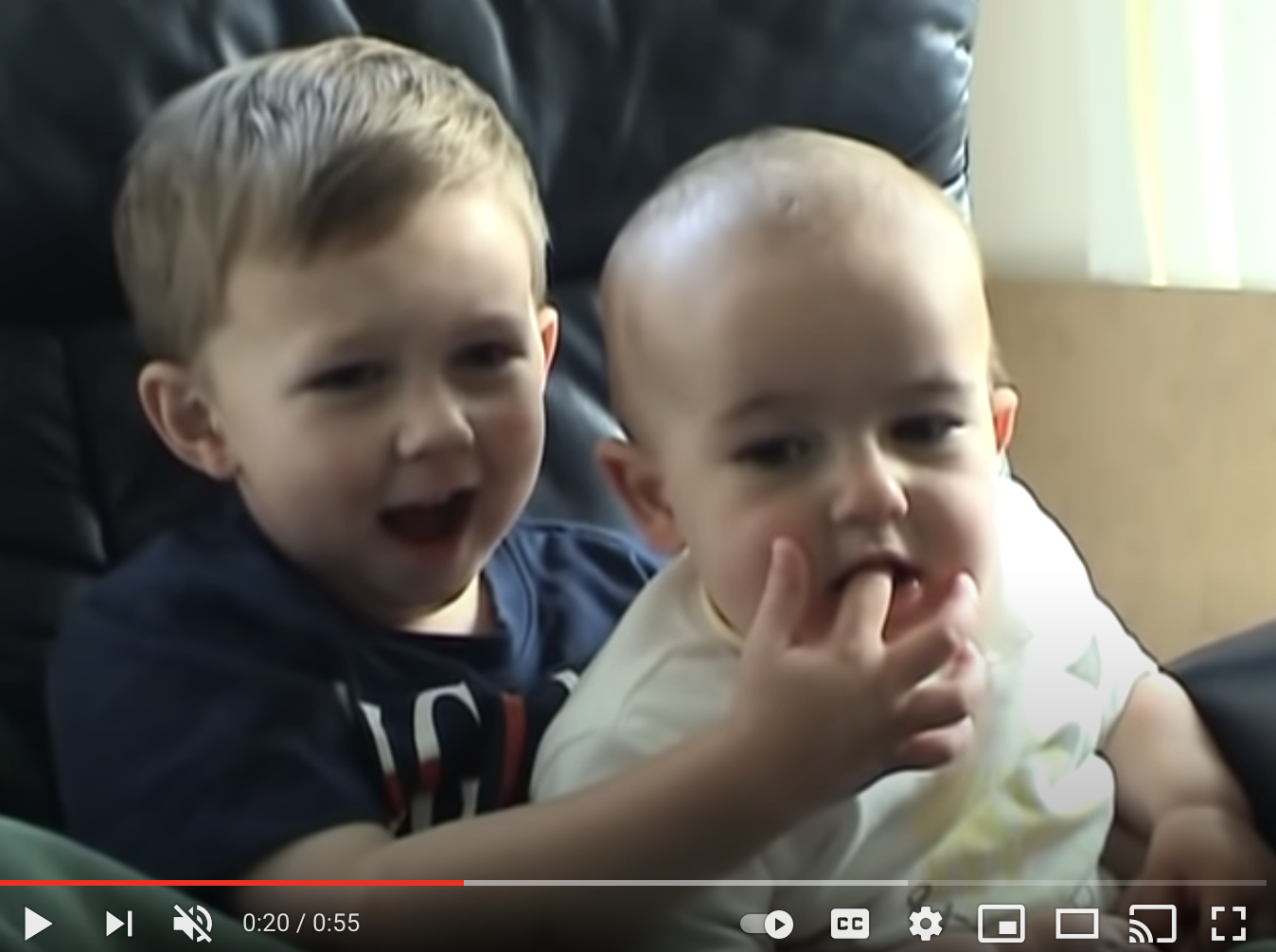 """A screenshot of the viral video """"Charlie bit me"""" shows a little boy biting his brother's finger."""