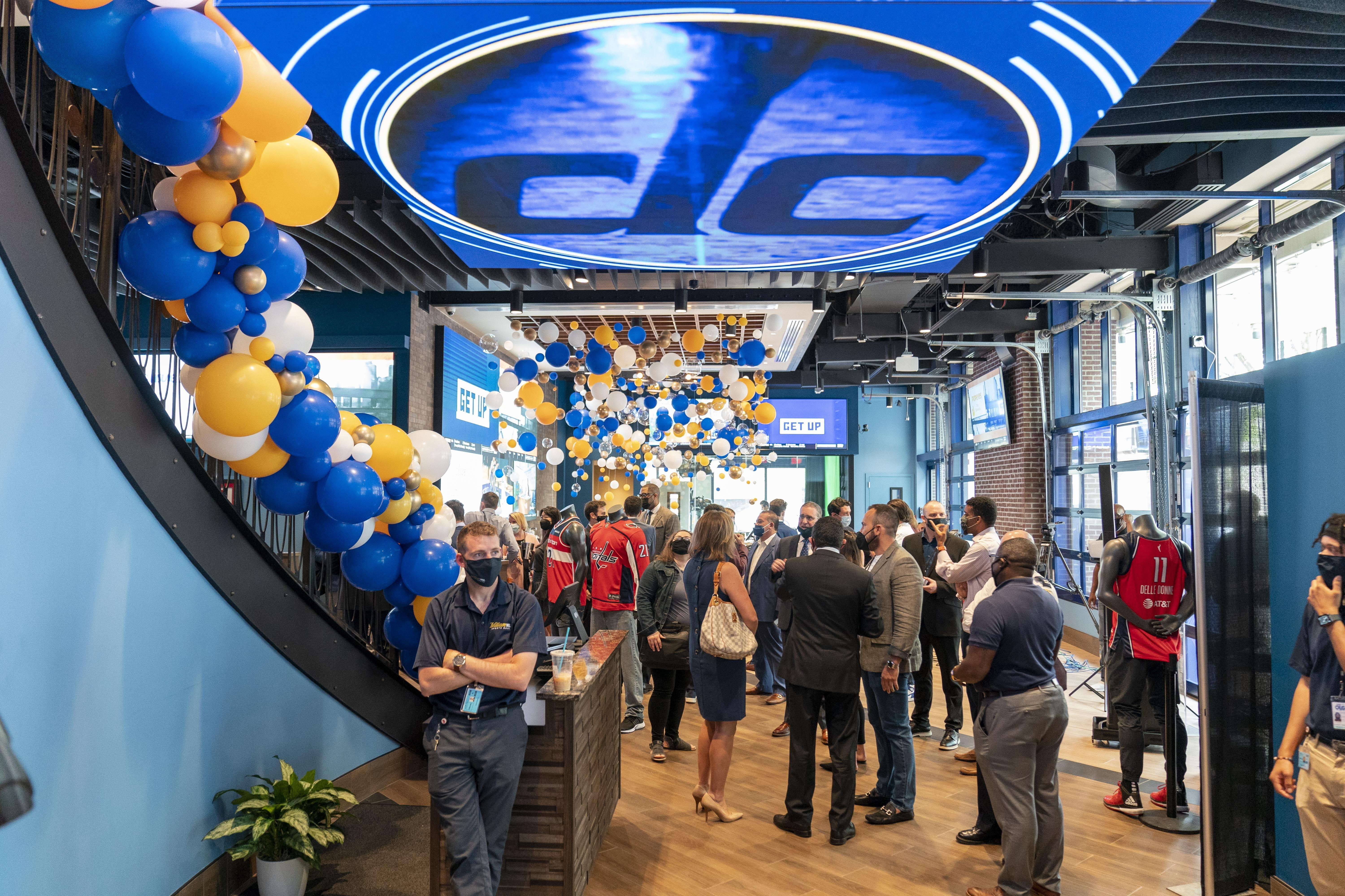 Guests mingle at a ribbon cutting ceremony at the William Hill Sportsbook at Capital One Arena in Washington, D.C.