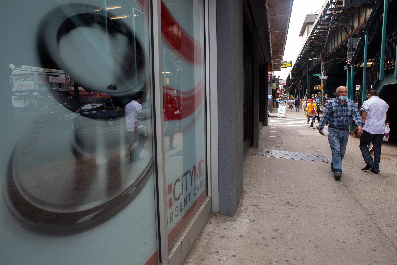 People walk down Brighton Beach Avenue in Brooklyn on May 24, 2021.