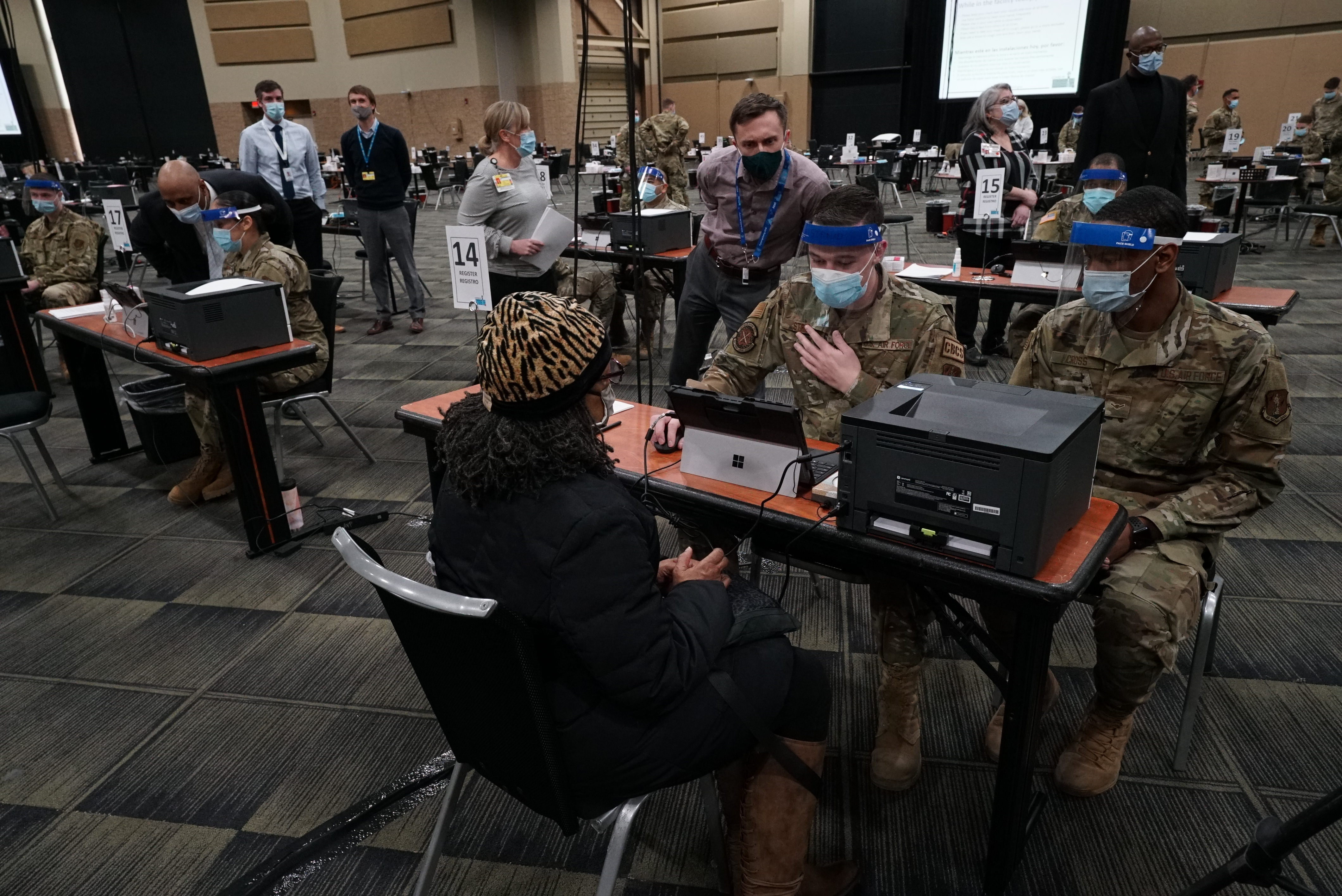 Residents receive COVID-19 vaccines at the Tinley Park Convention Center in January. The mass vaccination site is closing along with two others in suburban Cook County as demand fades.