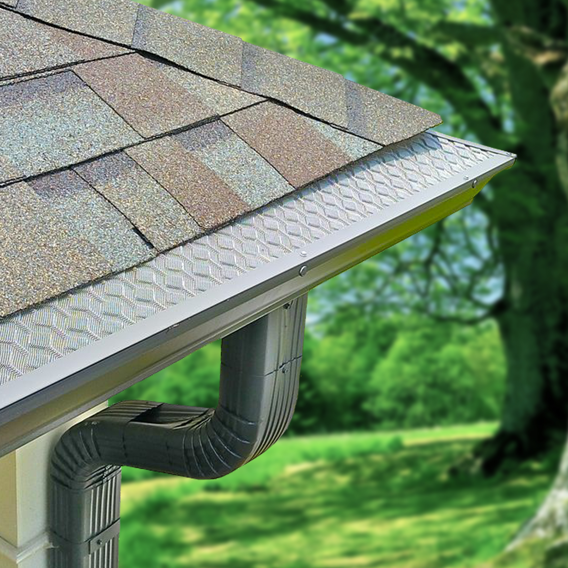 A HomeCraft gutter guard on the roof of a house near green trees.
