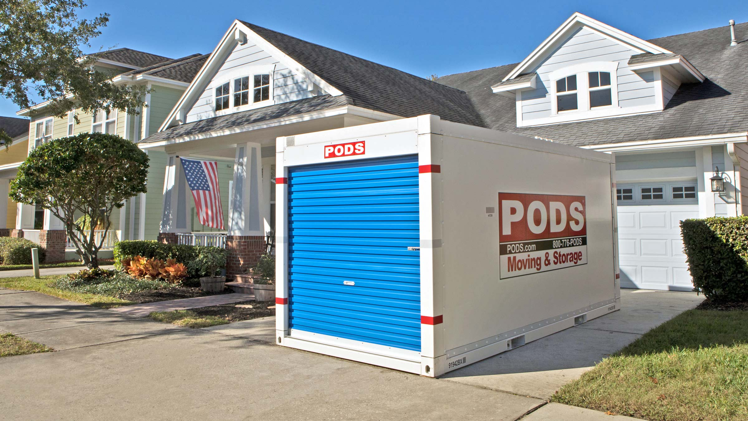PODS container in the driveway in front of a house