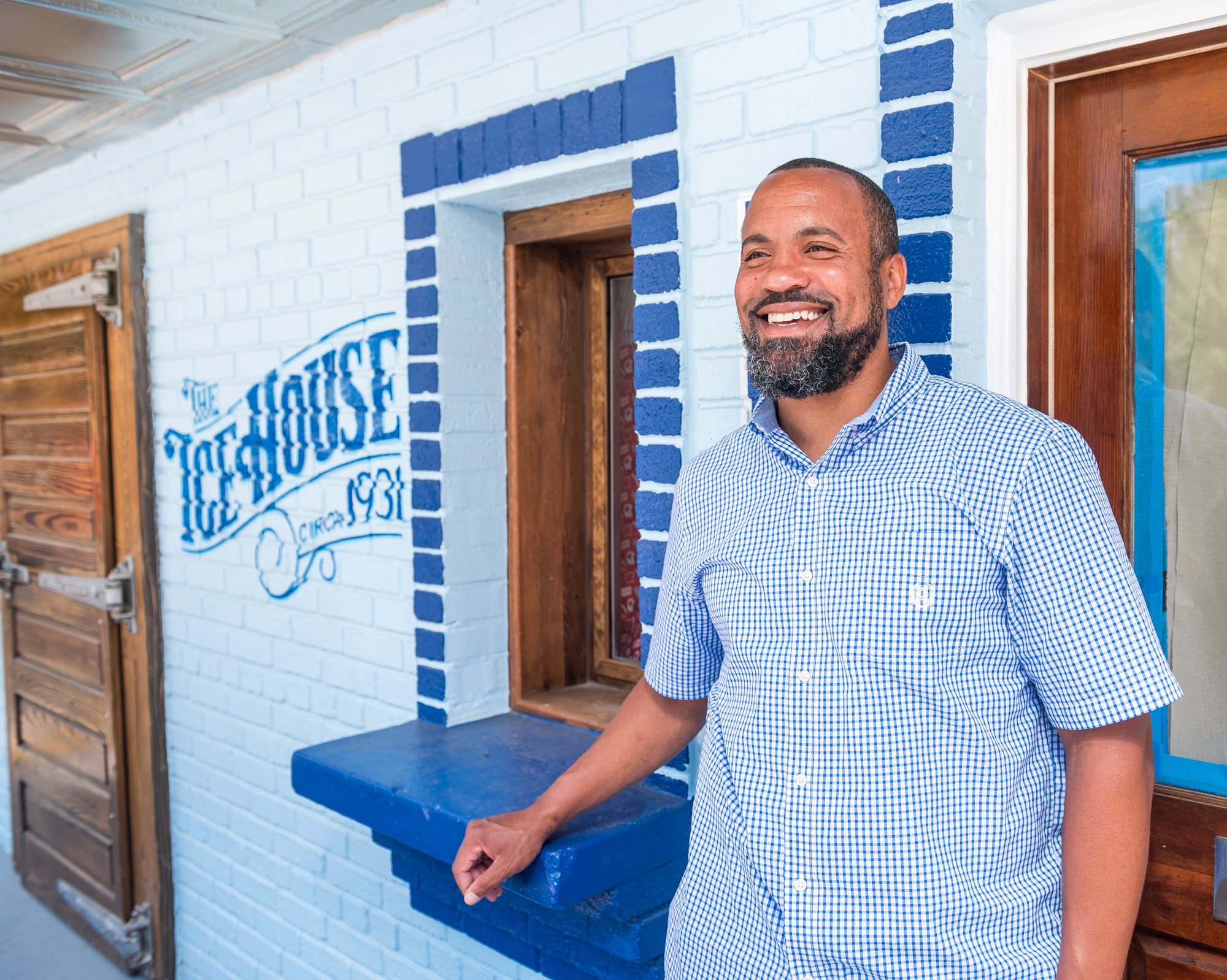 Brandon Byrd smiles in front of his walk-up window in Alexandria.