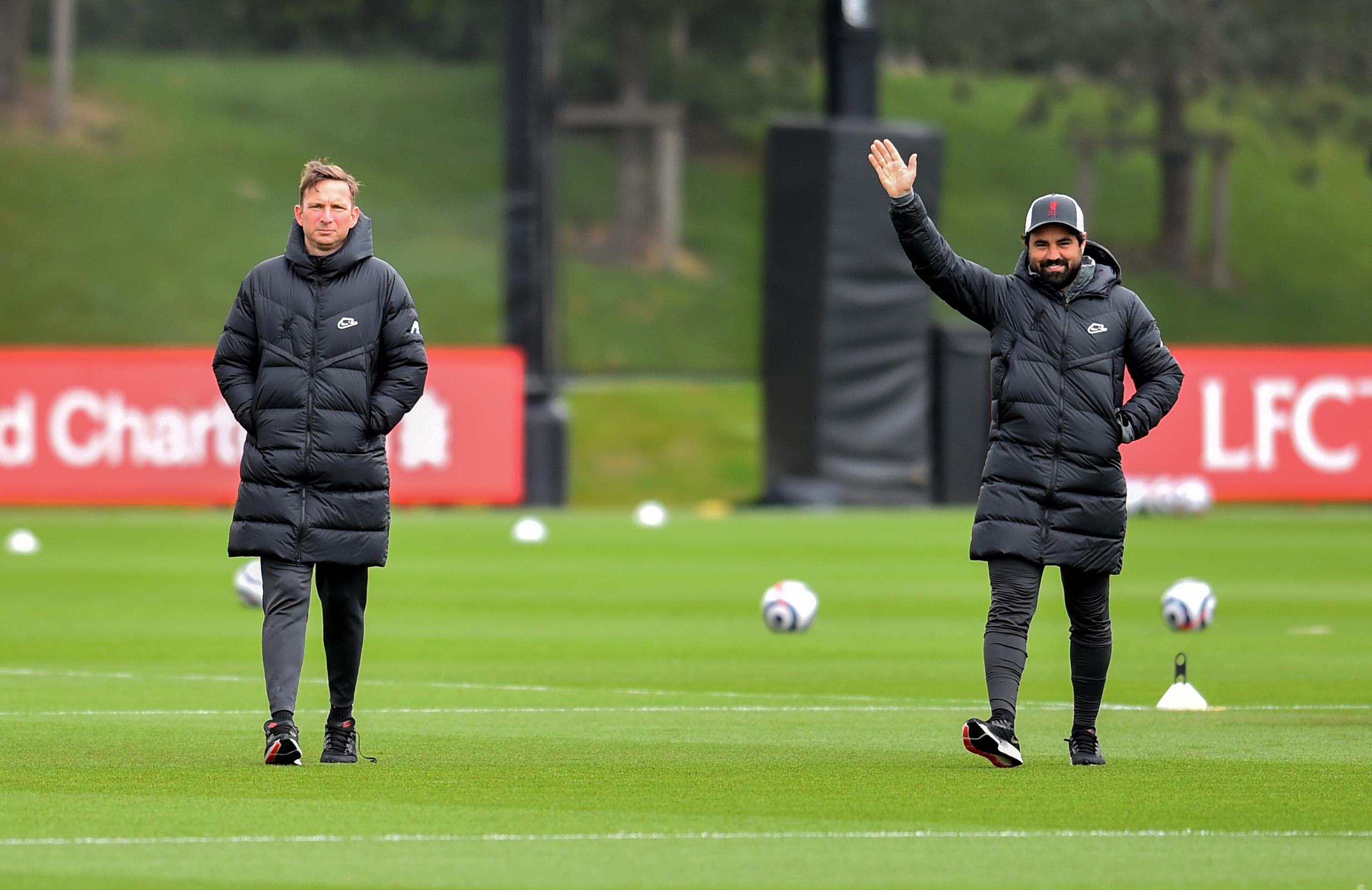 Pep Lijnders and Vitor Matos, Liverpool's elite development coach, at the AXA Training Centre.