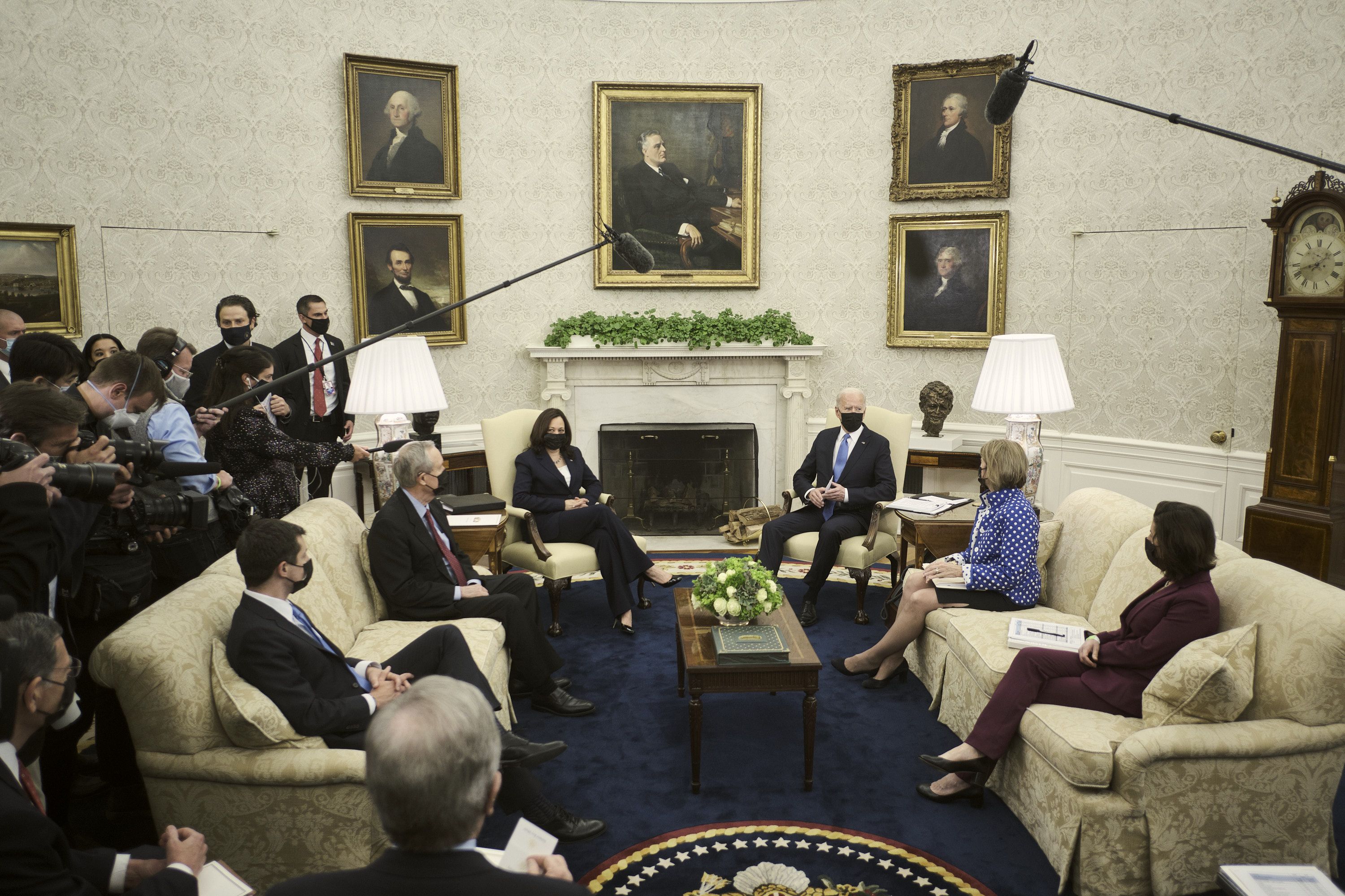 US President Joe Biden, center right, wears a protective mask while speaking during a meeting in the Oval Office of the White House in Washington, DC, on May 13, 2021.