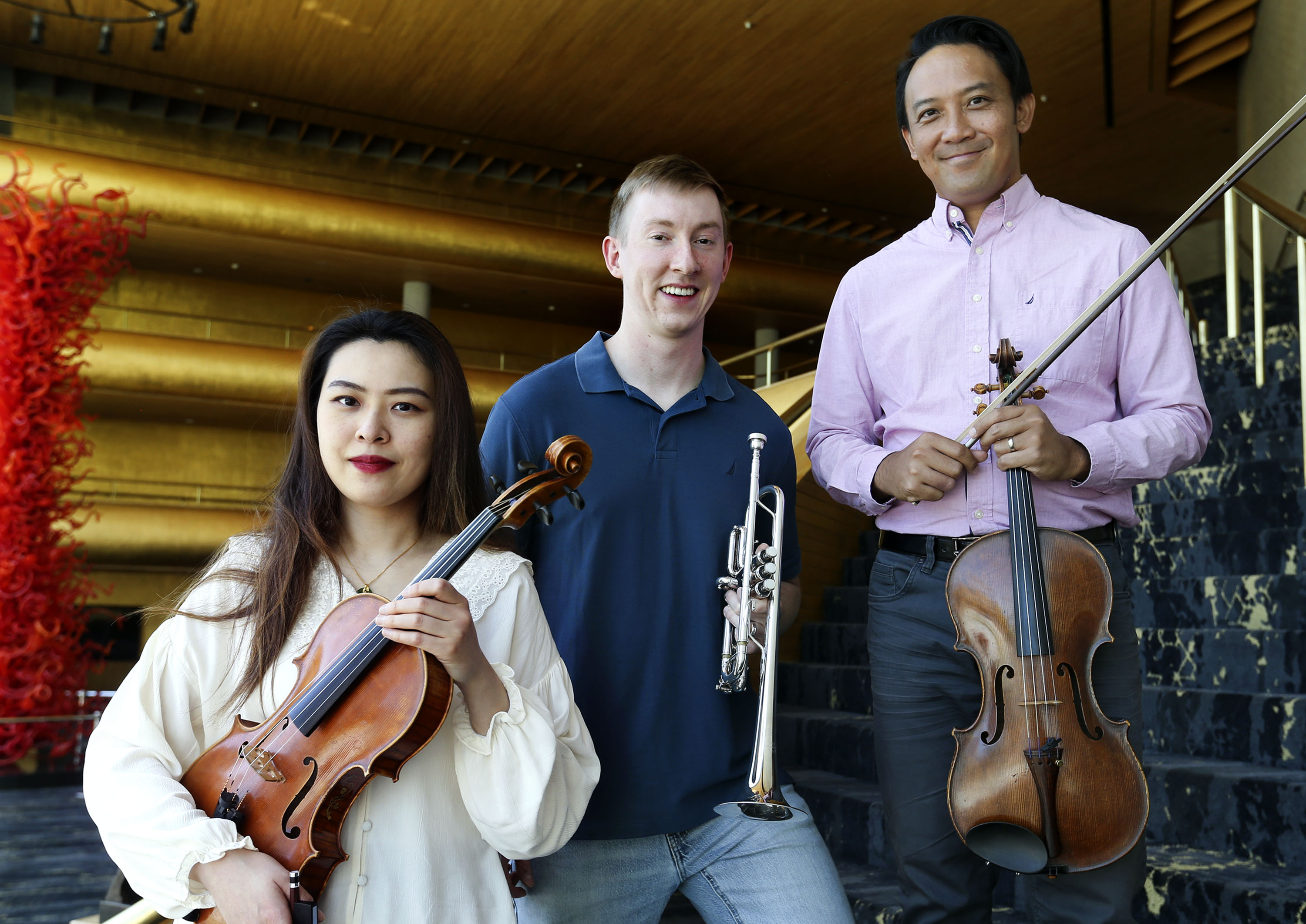 Yuan Qi, Paul Torrisi and JT Posadas, the newest members of the Utah Symphony, are photographed at Abravanel Hall.
