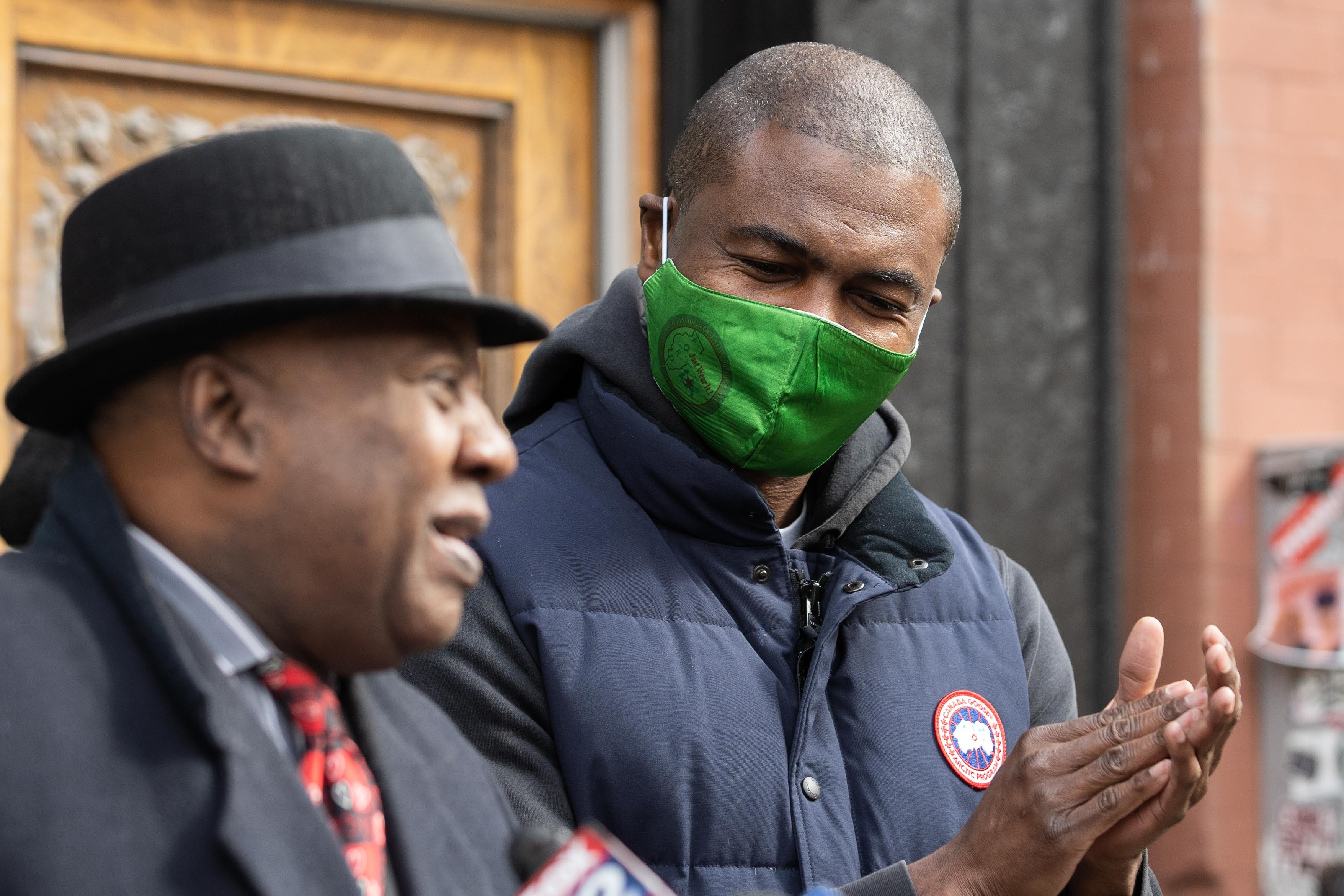 State Rep. La Shawn Ford claps as former state Sen. Ricky Hendon speaks during a press conference outside Nature's Care West Loop in the West Town neighborhood, where cannabis equity advocates announced the introduction of House Bill 327, Tuesday morning, March 16, 2021.