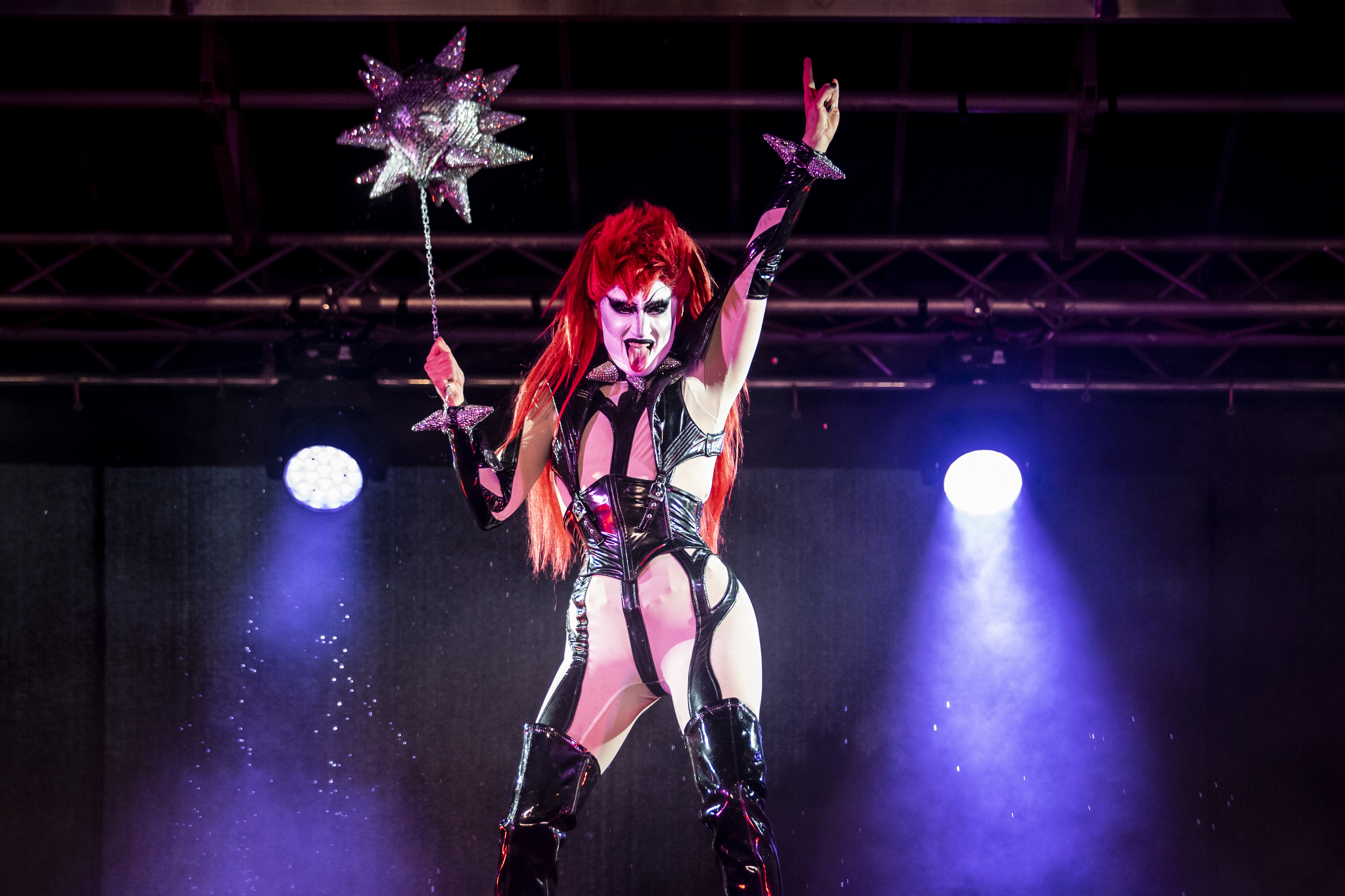 """Gottmik performs Friday night during """"Drive 'N Drag Saves 2021"""" in the parking lot at Soldier Field."""