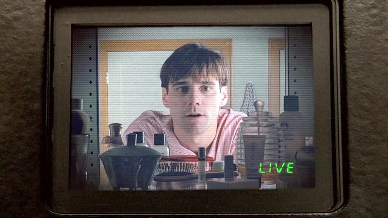 Truman looking in his bathroom mirror camera in Truman Show