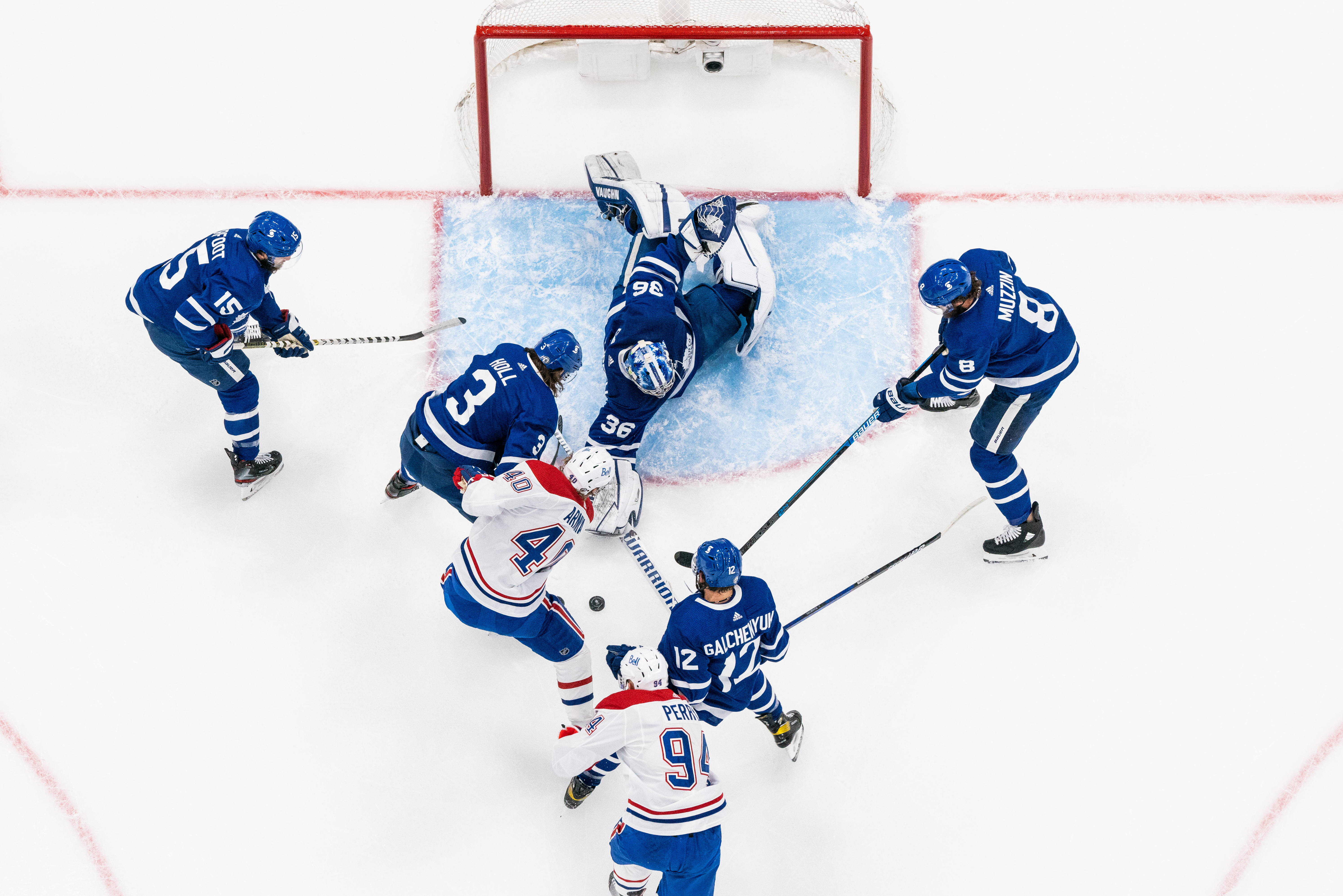 Jack Campbell #36 of the Toronto Maple Leafs attempts to clear the puck against Joel Armia #40 of the Montreal Canadiens during the third period in Game Five of the First Round of the 2021 Stanley Cup Playoffs at the Scotiabank Arena on May 27, 2021 in Toronto, Ontario, Canada.