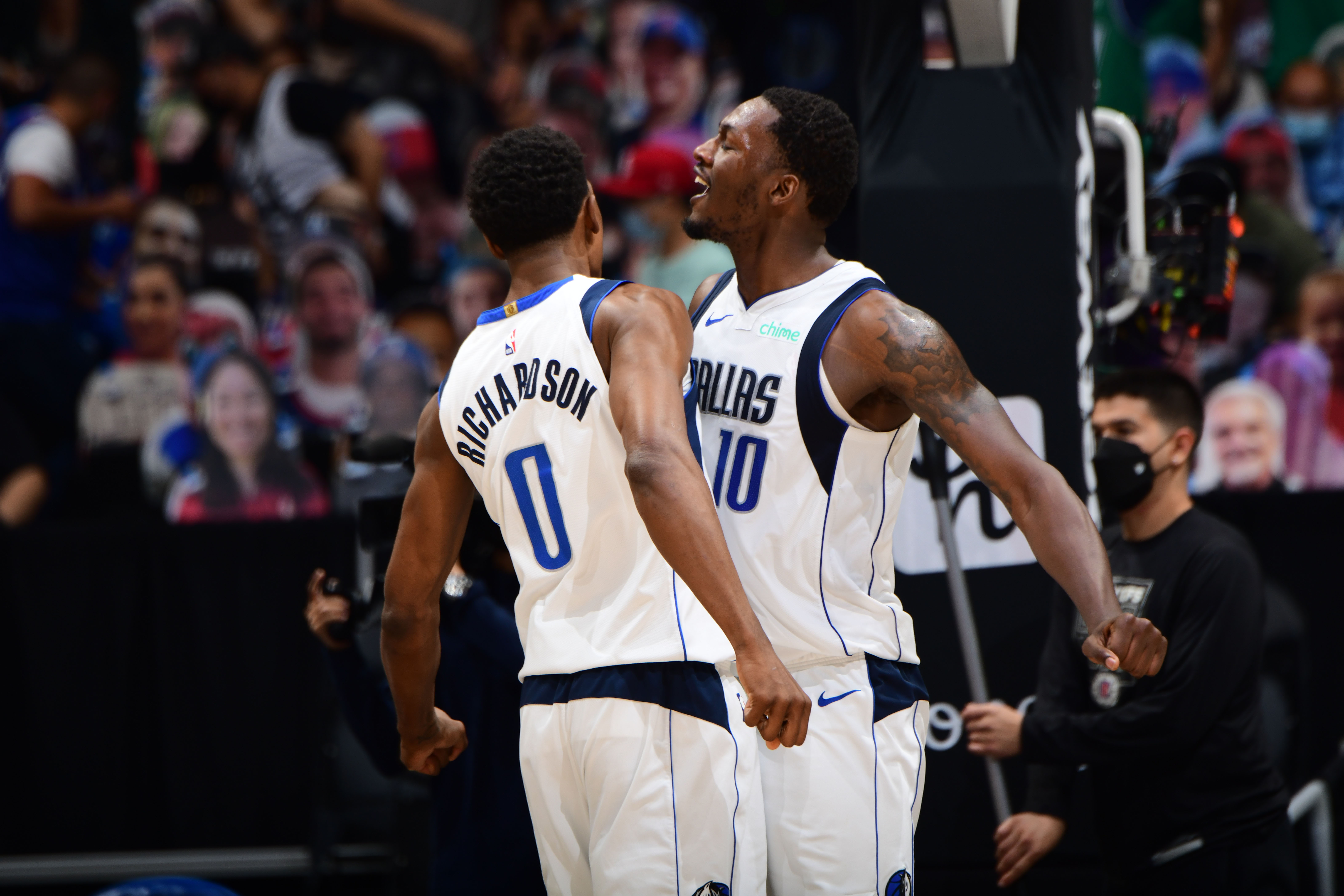 Background:LOS ANGELES, CA - MAY 25: Josh Richardson #0 and Dorian Finney-Smith #10 of the Dallas Mavericks celebrate during the game against the LA Clippers during Round 1, Game 2 of the 2021 NBA Playoffs on May 25, 2021 at STAPLES Center in Los Angeles, California.