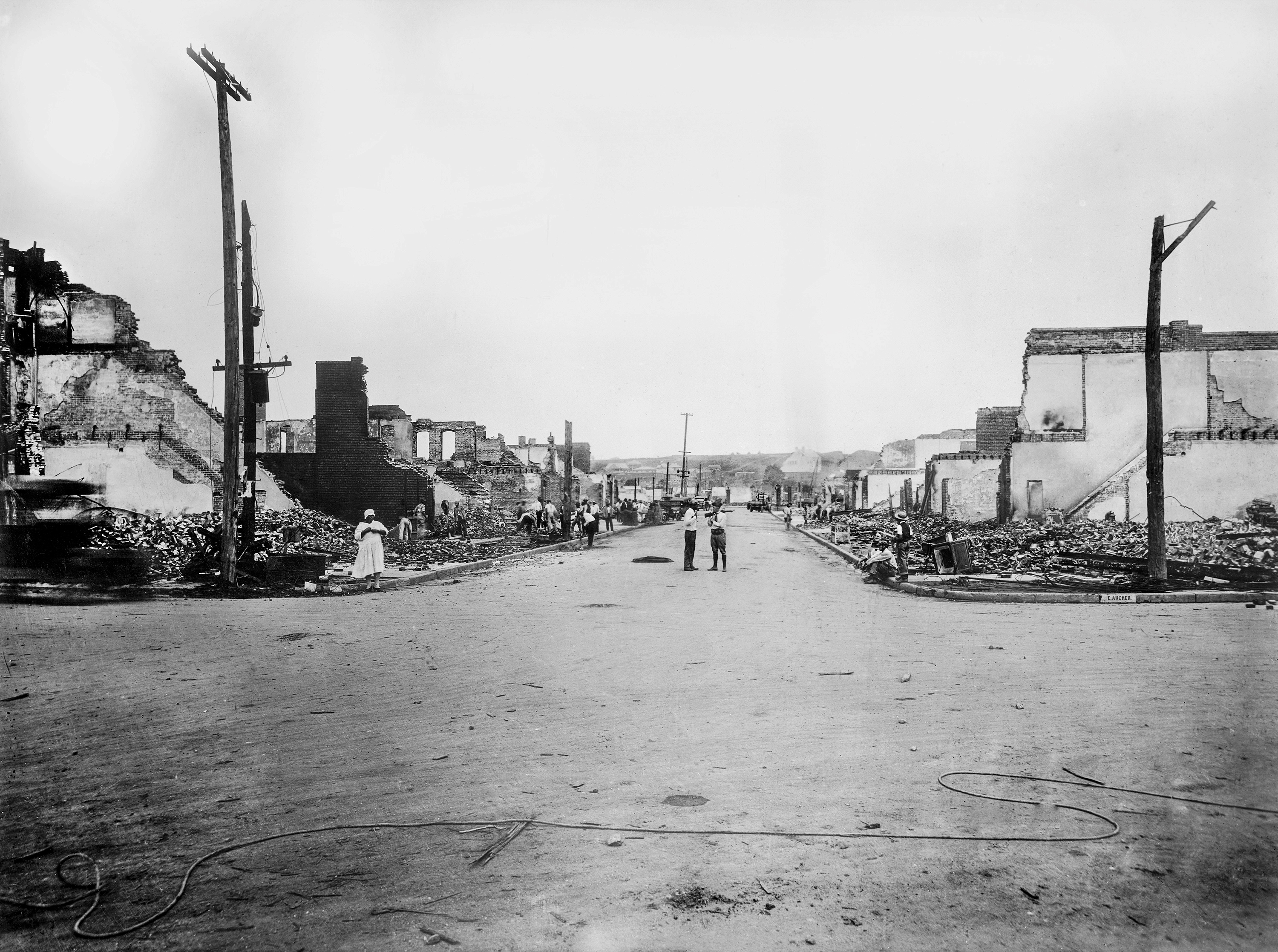 An intersection of two streets in Tulsa showing burned-out houses.