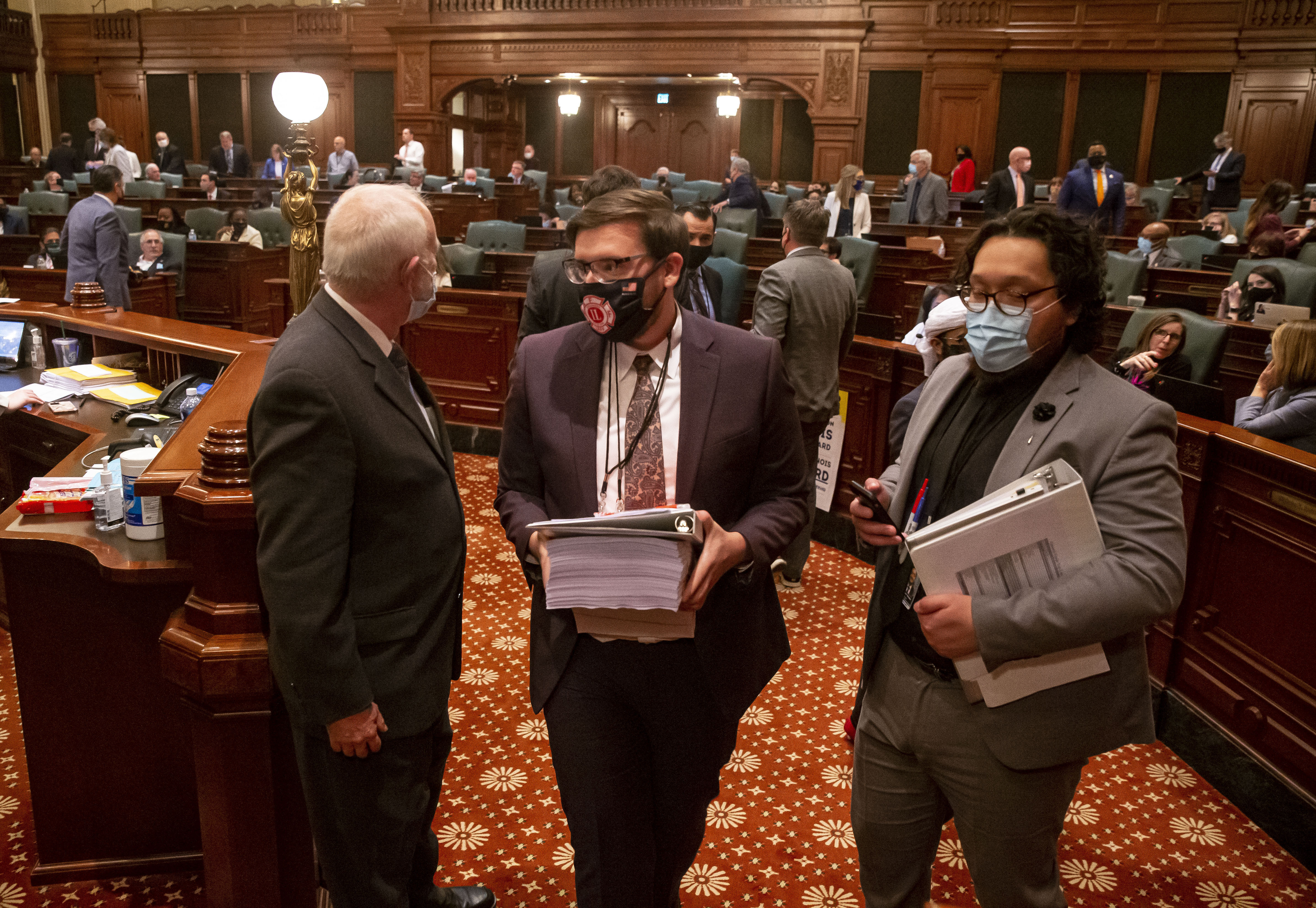 Staff leave floor of the Illinois House of Representatives after the budget is passed around midnight on the last day of session at the Illinois State Capitol in Springfield early Tuesday.