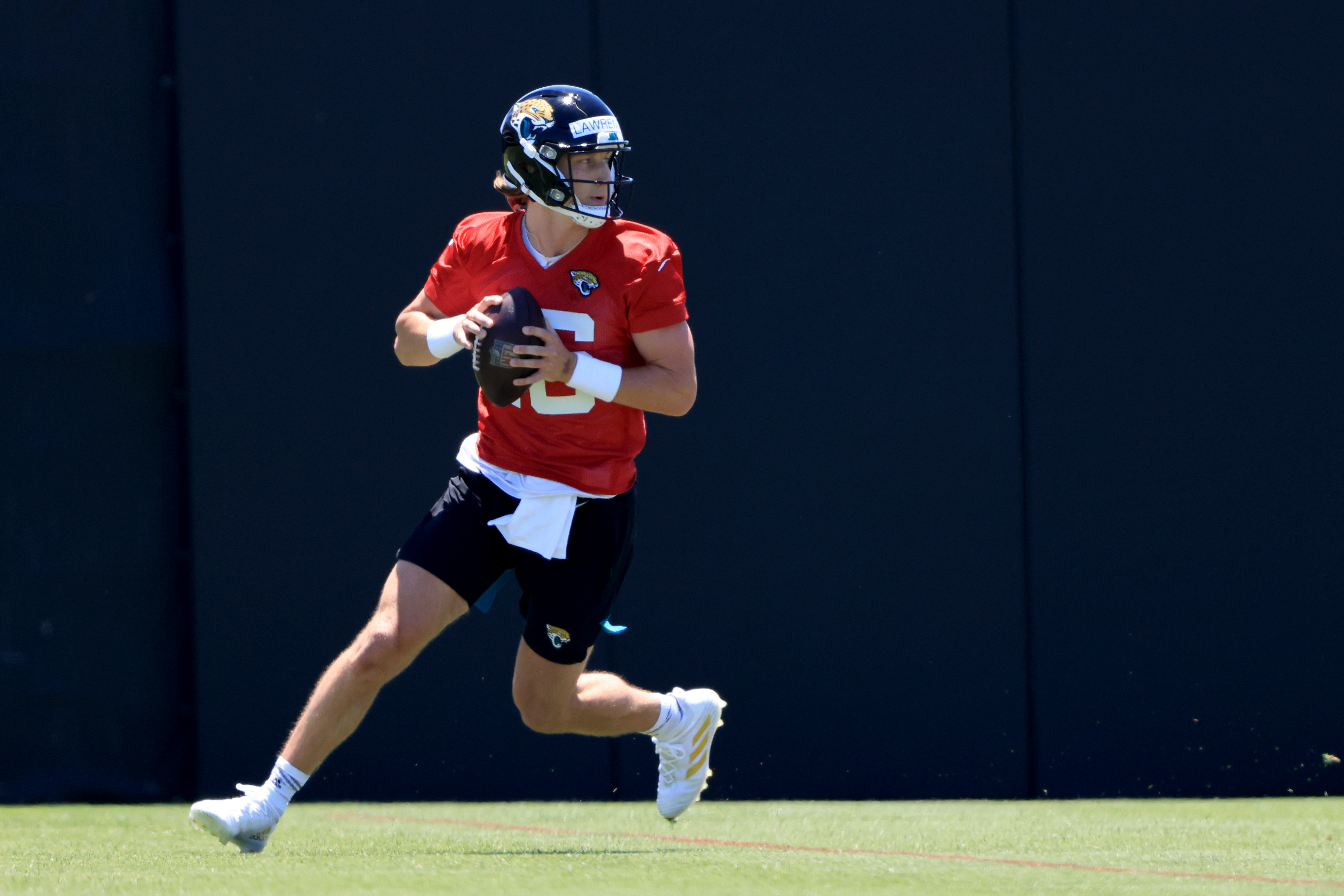 Trevor Lawrence #16 of the Jacksonville Jaguars runs drills during Jacksonville Jaguars Training Camp at TIAA Bank Field on May 15, 2021 in Jacksonville, Florida.