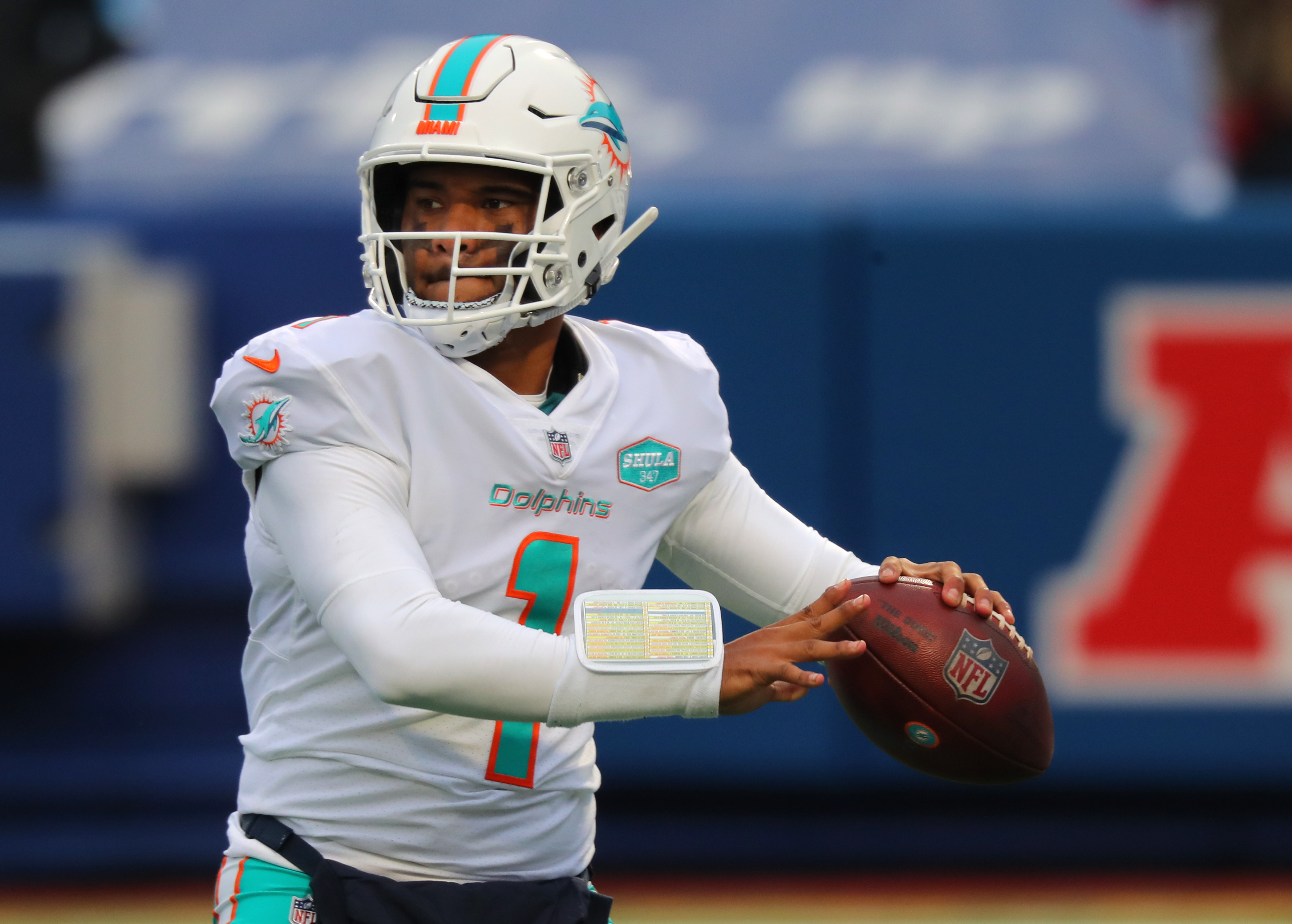 Tua Tagovailoa #1 of the Miami Dolphins looks to throw a pass against the Buffalo Bills at Bills Stadium on January 3, 2021 in Orchard Park, New York.