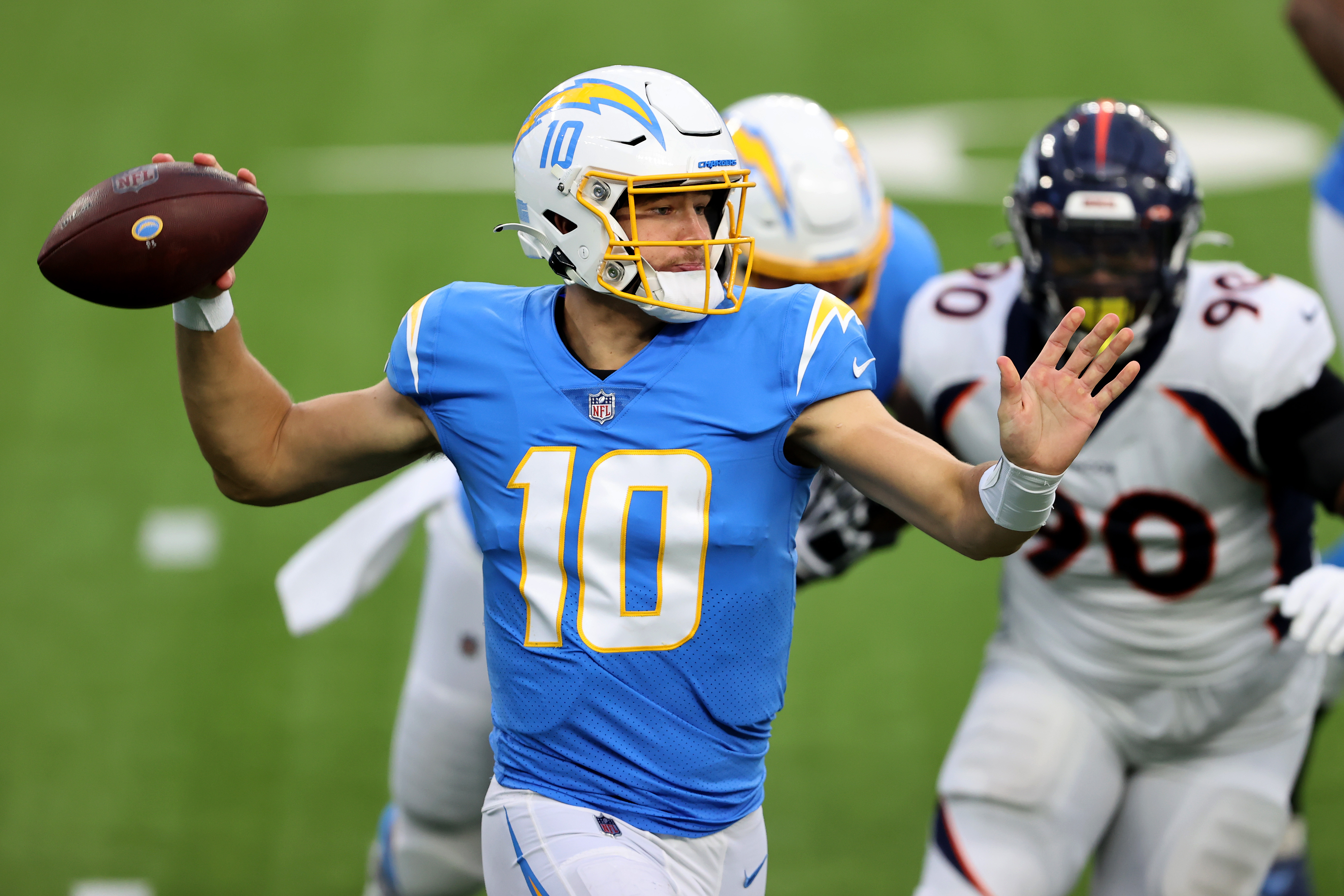 Justin Herbert #10 of the Los Angeles Chargers passes the ball during the first half of a game against the Denver Broncos at SoFi Stadium on December 27, 2020 in Inglewood, California.