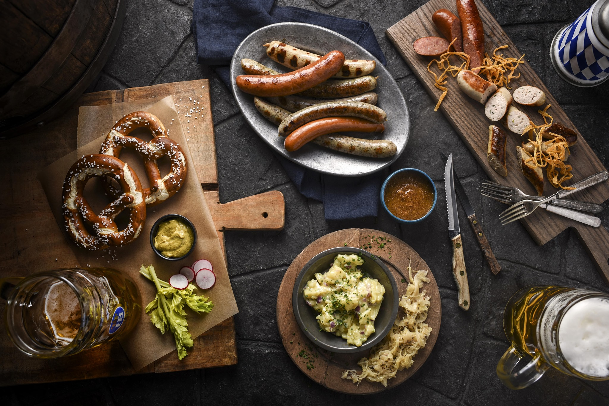 Pretzels, sausages, and more German food on cutting boards