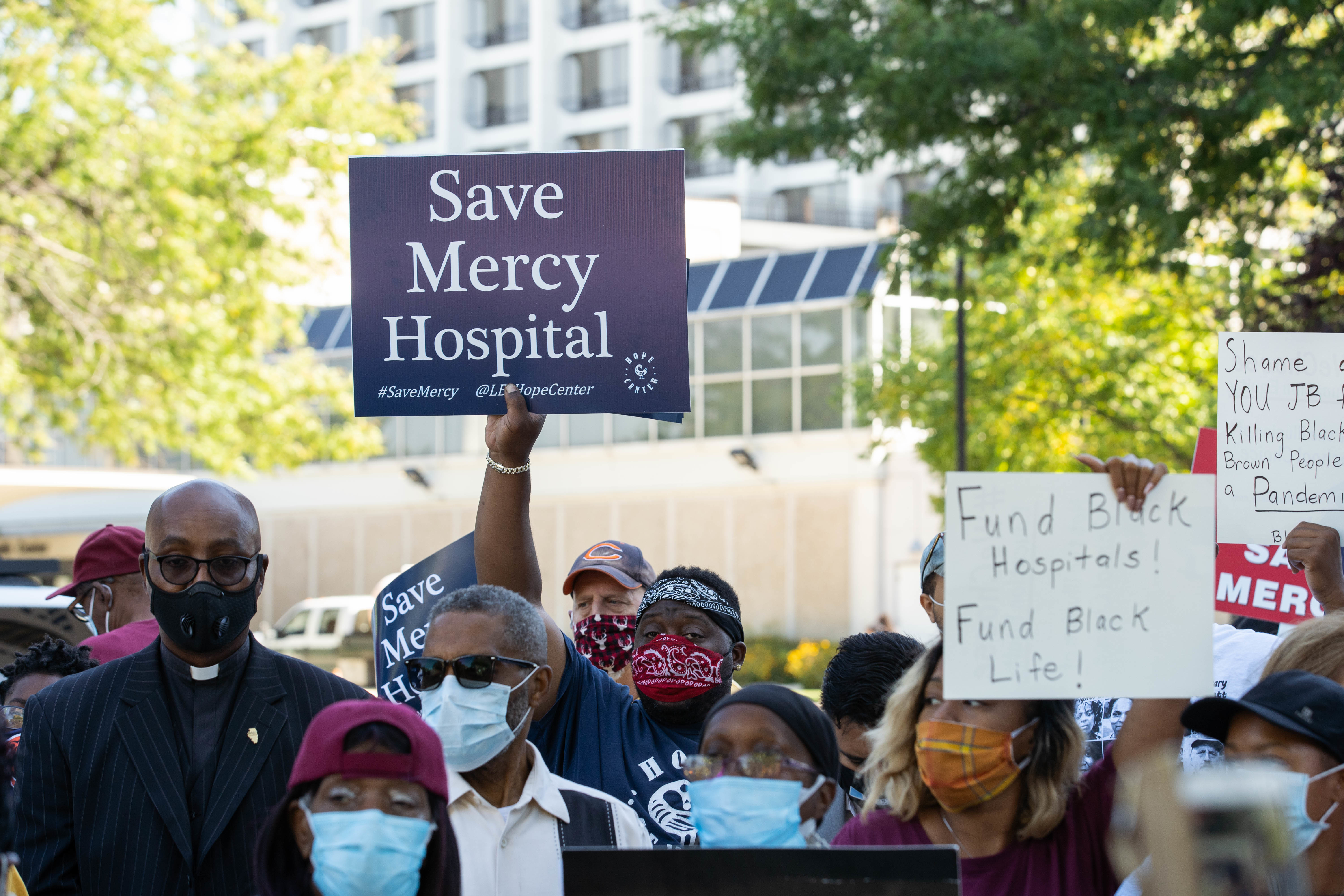 Local officials, community activists and Mercy Hospital and Medical Center employees attend a protest outside Mercy Hospital and Medical Center in Bronzeville Thursday morning, Sept. 3, 2020.