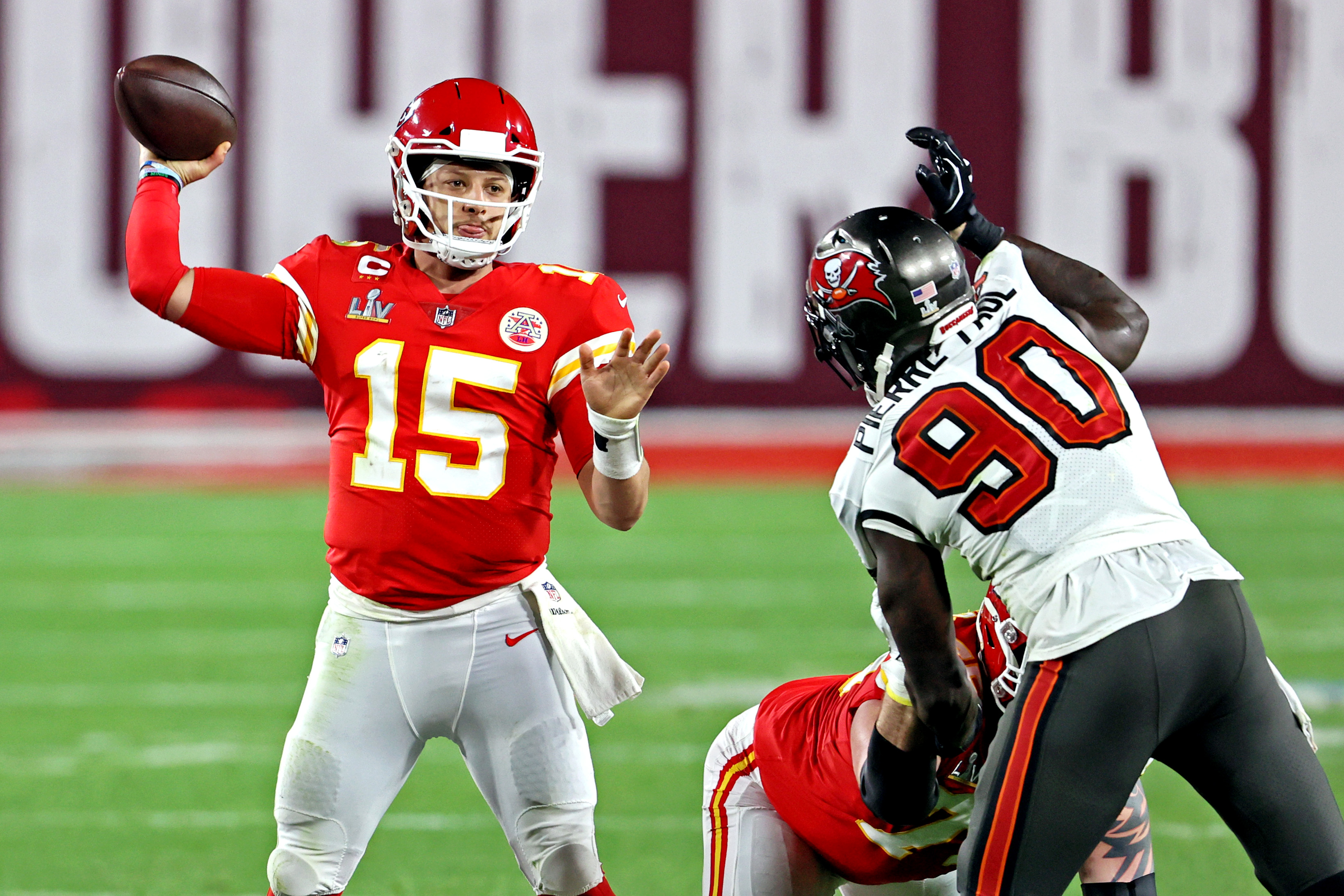 Kansas City Chiefs quarterback Patrick Mahomes throws a pass against Tampa Bay Buccaneers outside linebacker Jason Pierre-Paul during the fourth quarter in Super Bowl LV at Raymond James Stadium.
