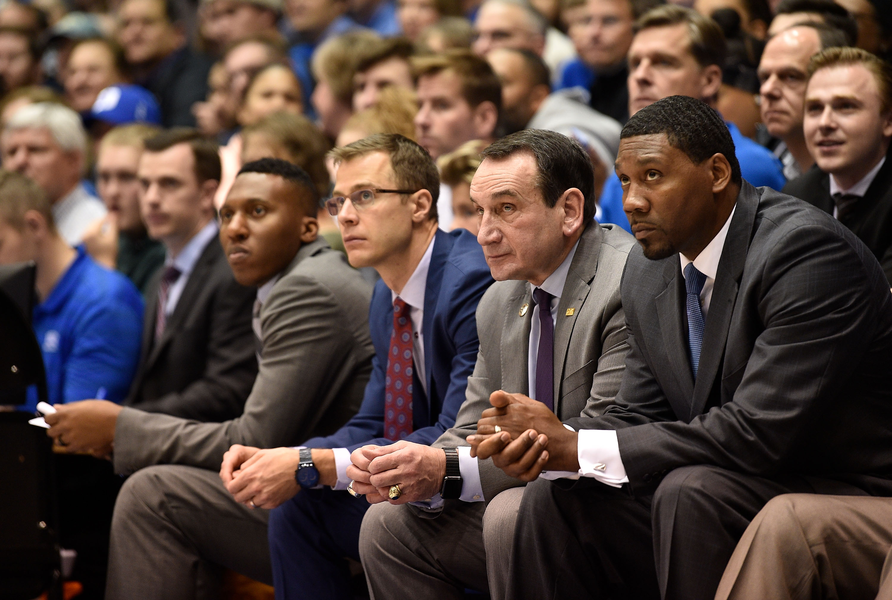 Coaches (L-R) Nolan Smith, Jon Scheyer, head coach Mike Krzyzewski and Nate James of the Duke Blue Devils watch during their game against the Princeton Tigers at Cameron Indoor Stadium on December 18, 2018 in Durham, North Carolina.