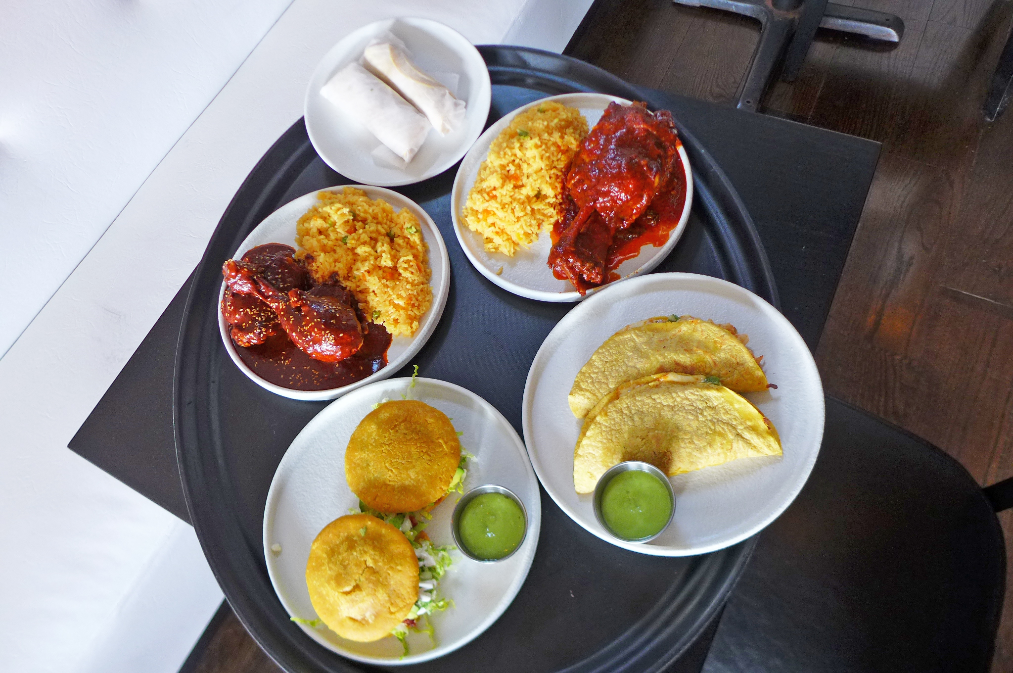 Four plates of food on a black and white background, mainly in shades of red and yellow.