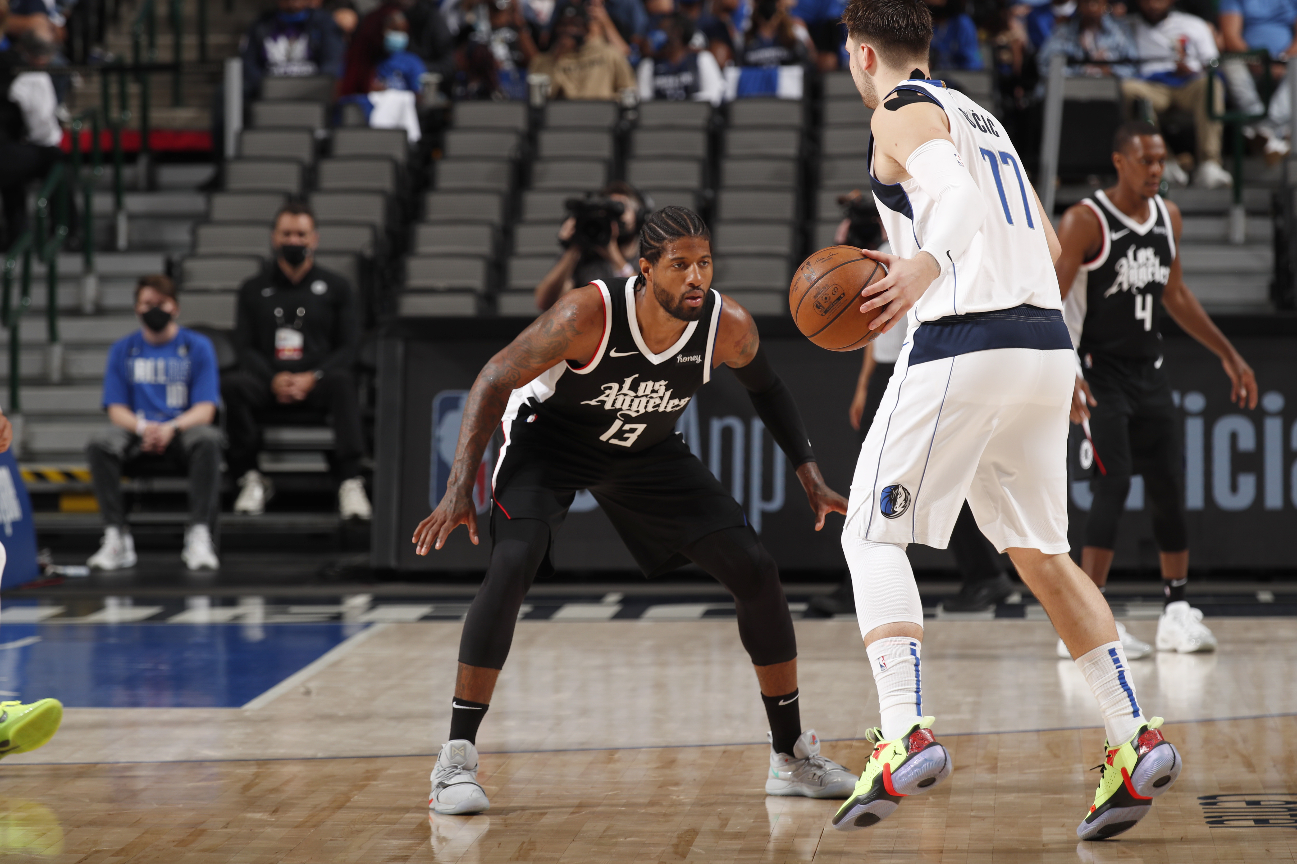Paul George of the LA Clippers plays defense on Luka Doncic of the Dallas Mavericks during Round 1, Game 3 of the 2021 NBA Playoffs on May 30, 2021 at the American Airlines Center in Dallas, Texas.