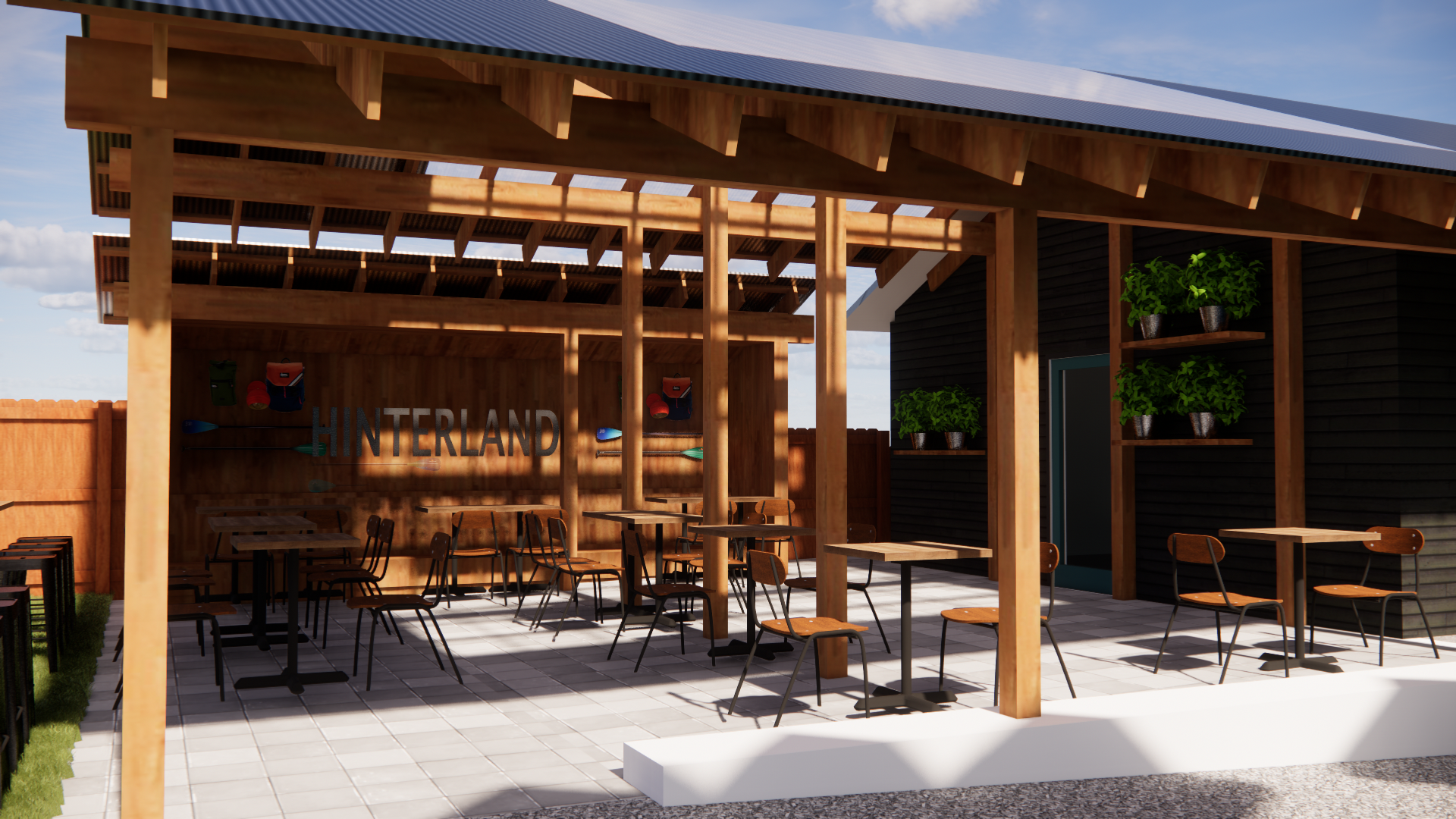 Tables and chairs are set up under a covered patio at Hinterland, with a bar out of frame.
