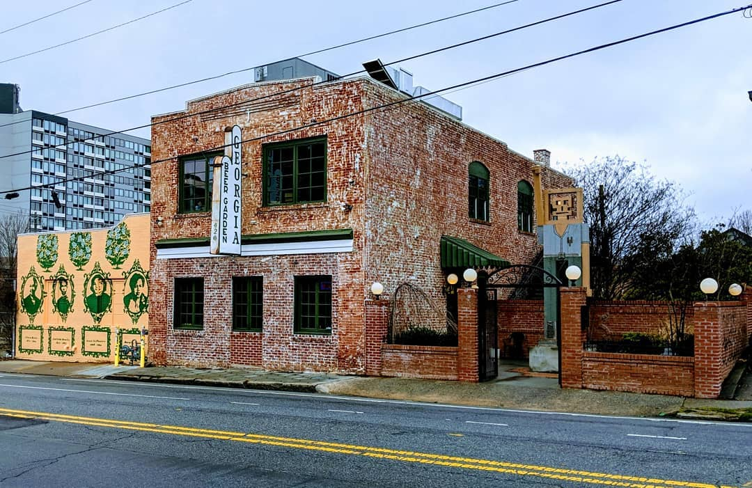 Looking toward the two-story brick building that is home to Georgia Beer Garden on a quick afternoon along Edgewood AVenue in Atlanta