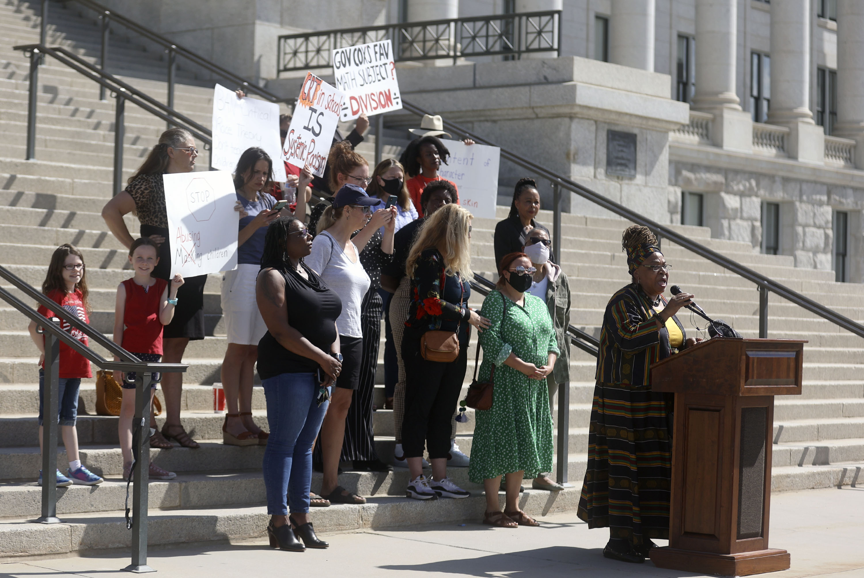 Educators and community activists stand on the steps of the Utah Capitol in Salt Lake City to protest a plan to pass a resolution encouraging the ban of critical race theory concepts.