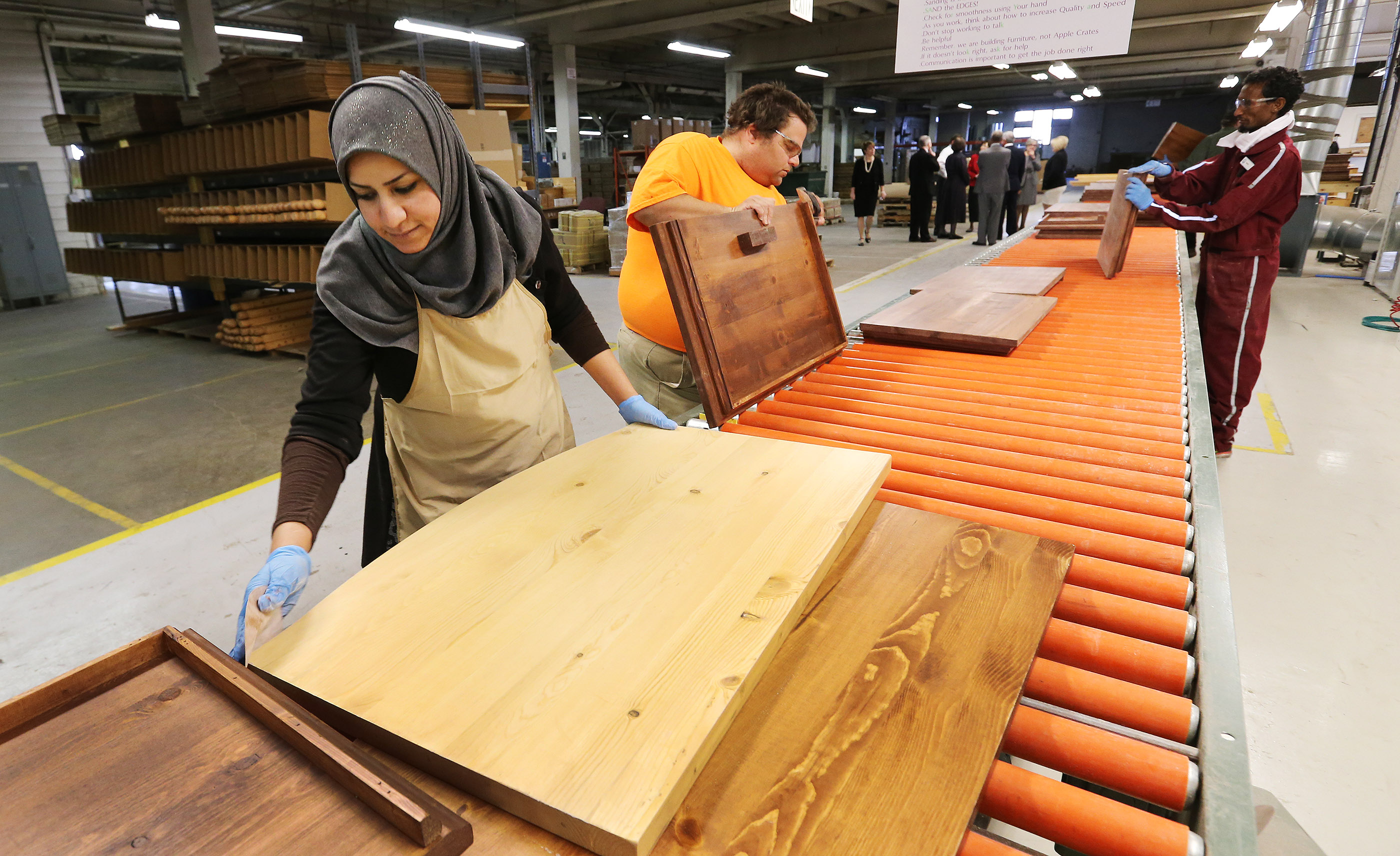A refugee builds furniture that will be donated to help other refugees resettle in the United States.
