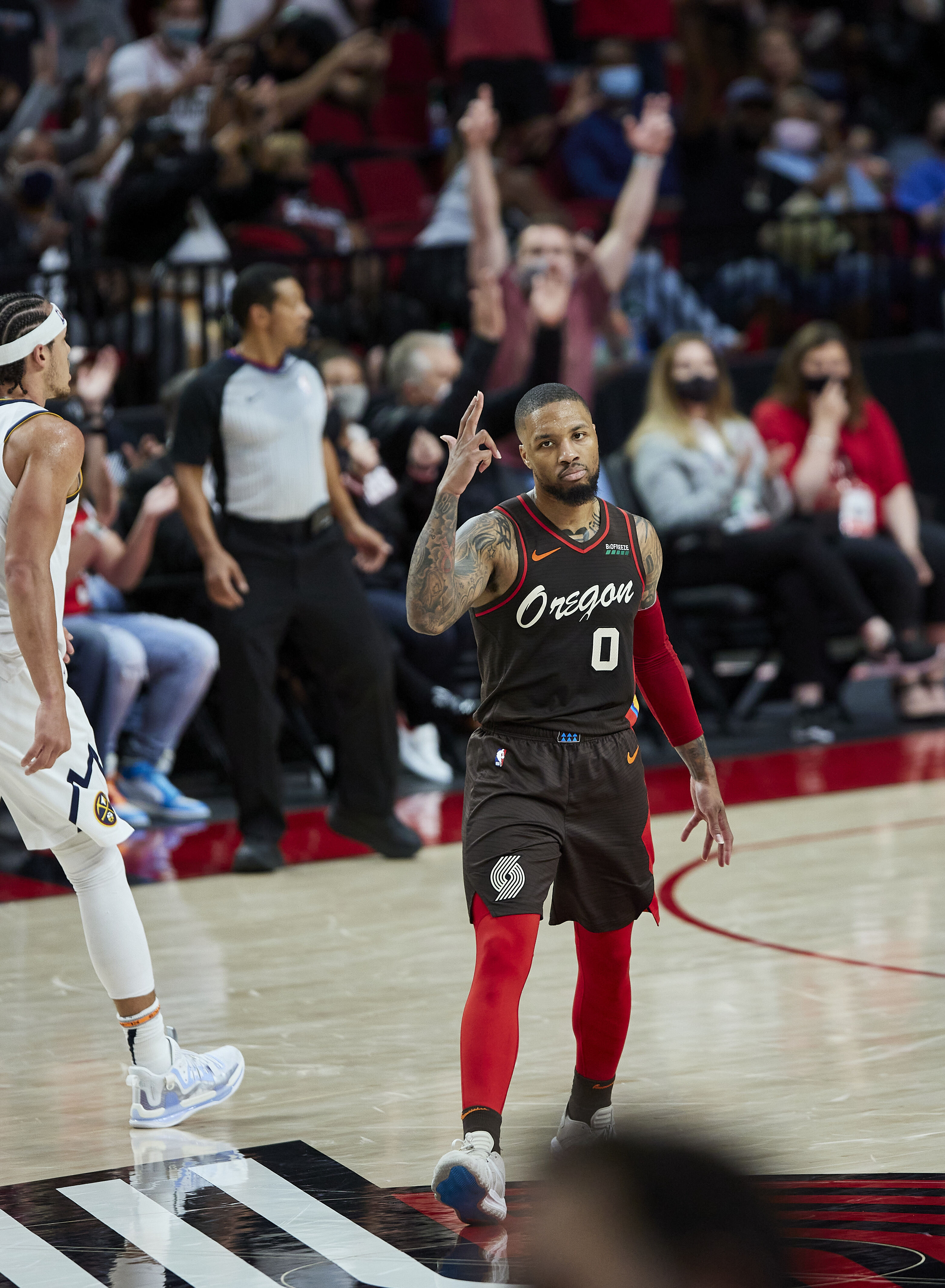 Portland Trail Blazers guard Damian Lillard reacts after making a 3-pointer against the Denver Nuggets in Game 6 of their playoff series.