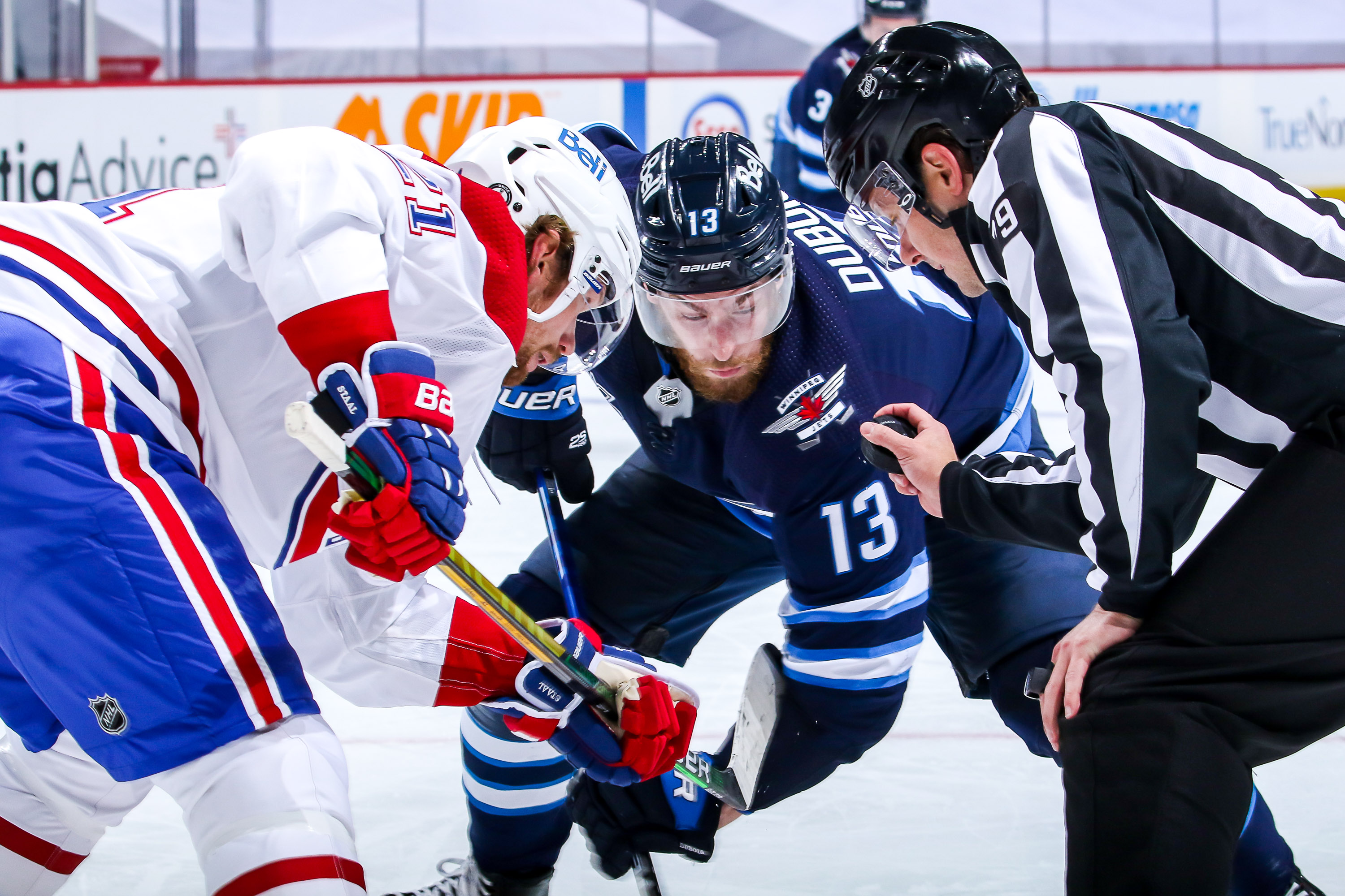 Eric Staal #21 of the Montreal Canadiens and Pierre-Luc Dubois #13 of the Winnipeg Jets get set for a second period face-off in Game One of the Second Round of the 2021 Stanley Cup Playoffs at the Bell MTS Place on June 2, 2021 in Winnipeg, Manitoba, Canada.