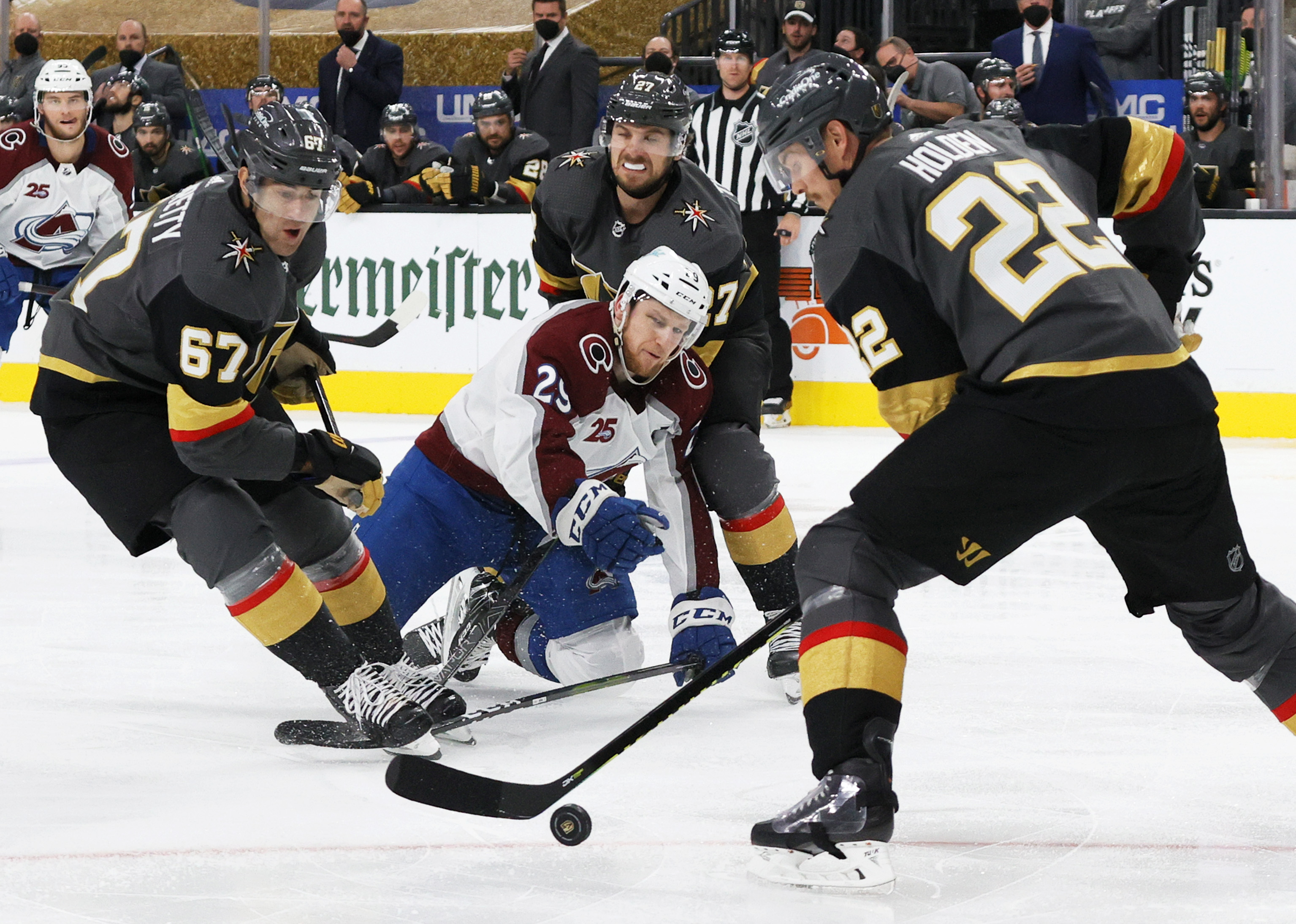 Nathan MacKinnon #29 of the Colorado Avalanche gets his stick caught in the skate of Max Pacioretty #67 of the Vegas Golden Knights as MacKinnon carried the puck against Shea Theodore #27 and Nick Holden #22 of the Golden Knights in the third period in Game Three of the Second Round of the 2021 Stanley Cup Playoffs at T-Mobile Arena on June 4, 2021 in Las Vegas, Nevada. The Golden Knights defeated the Avalanche 3-2.