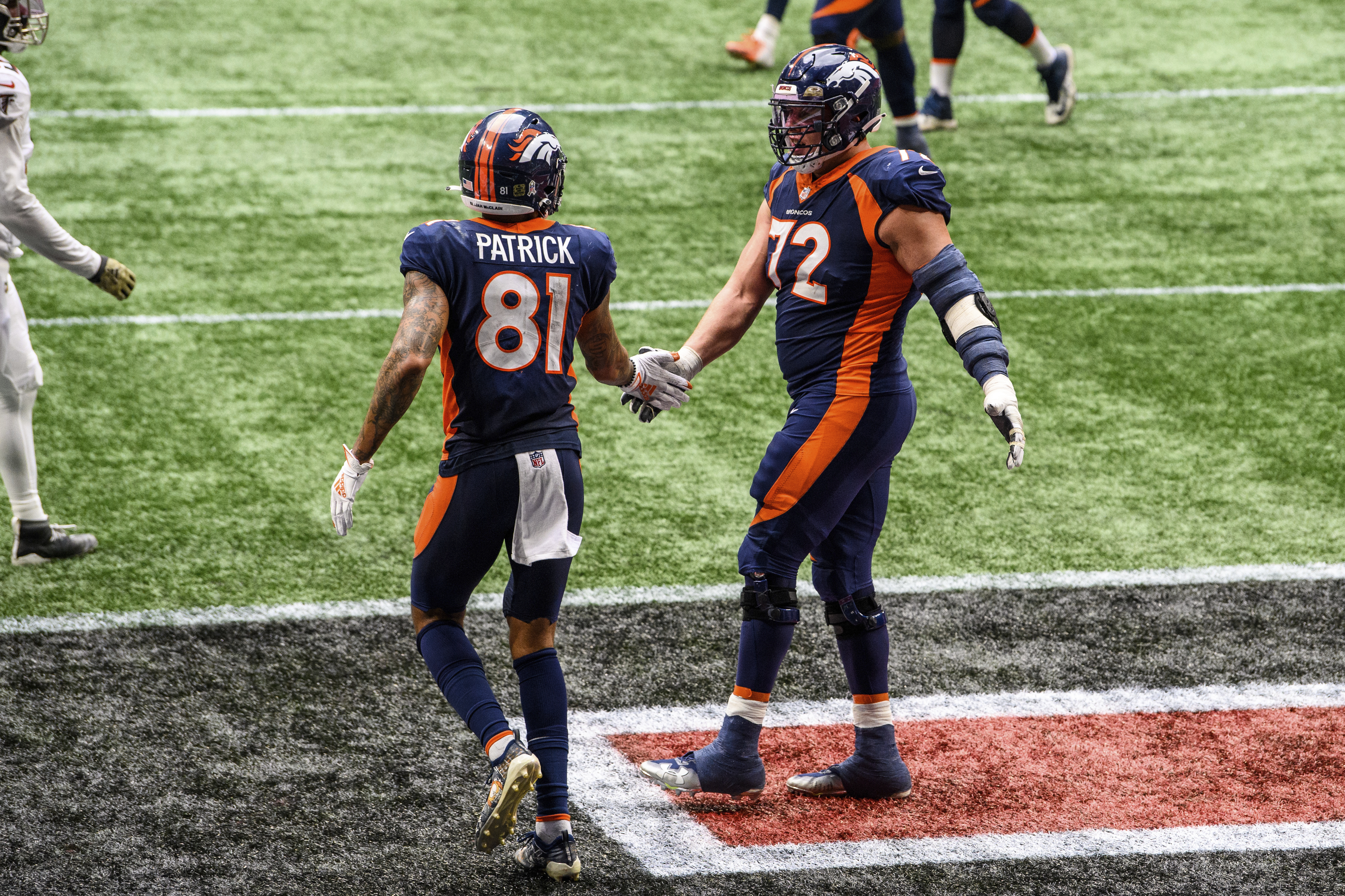 Denver Broncos offensive tackle Garett Bolles celebrates with wide receiver Tim Patrick after a touchdown.