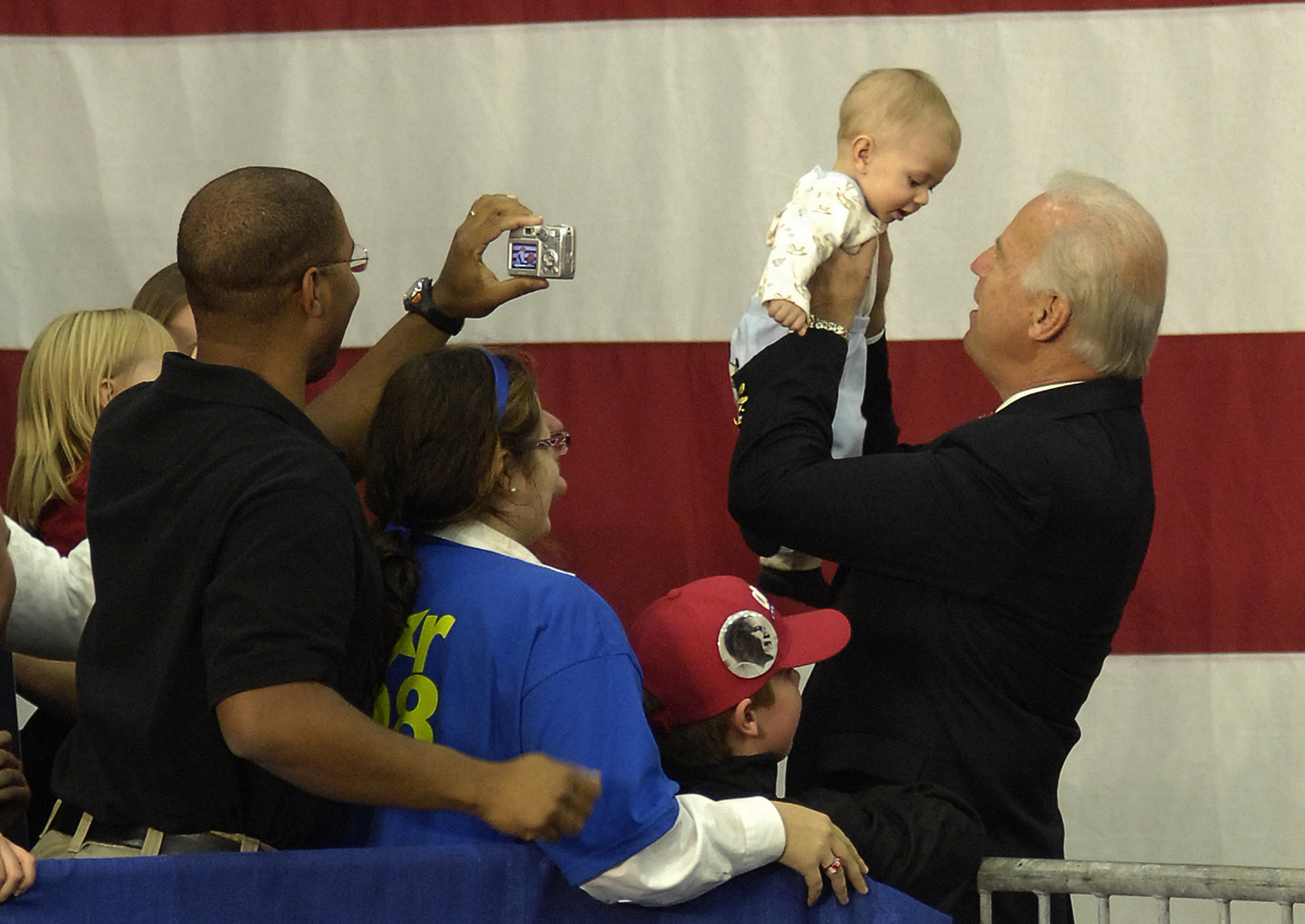 Joe Biden holds up a baby during a campaign rally in Williamsport, Pennsylvania, in October 2008.