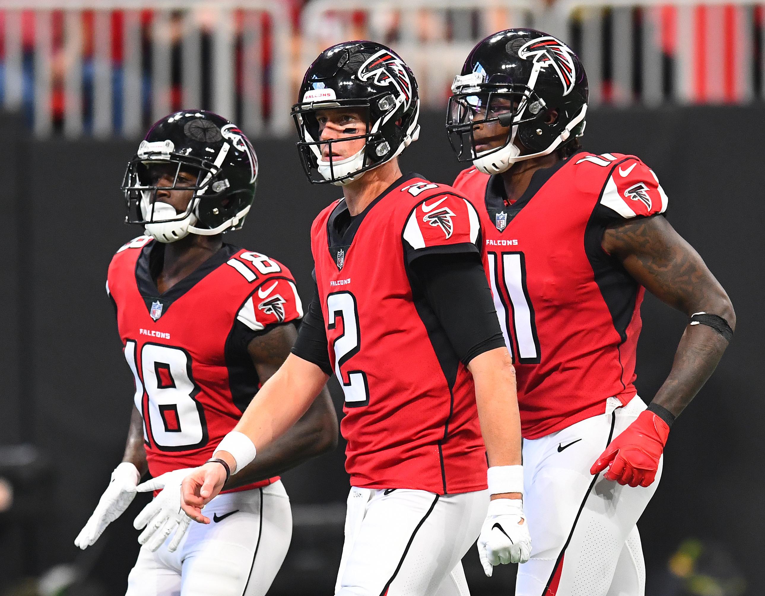 Calvin Ridley #18, Matt Ryan #2, and Julio Jones #11 of the Atlanta Falcons take the field during the second quarter against the New Orleans Saints at Mercedes-Benz Stadium on September 23, 2018 in Atlanta, Georgia.