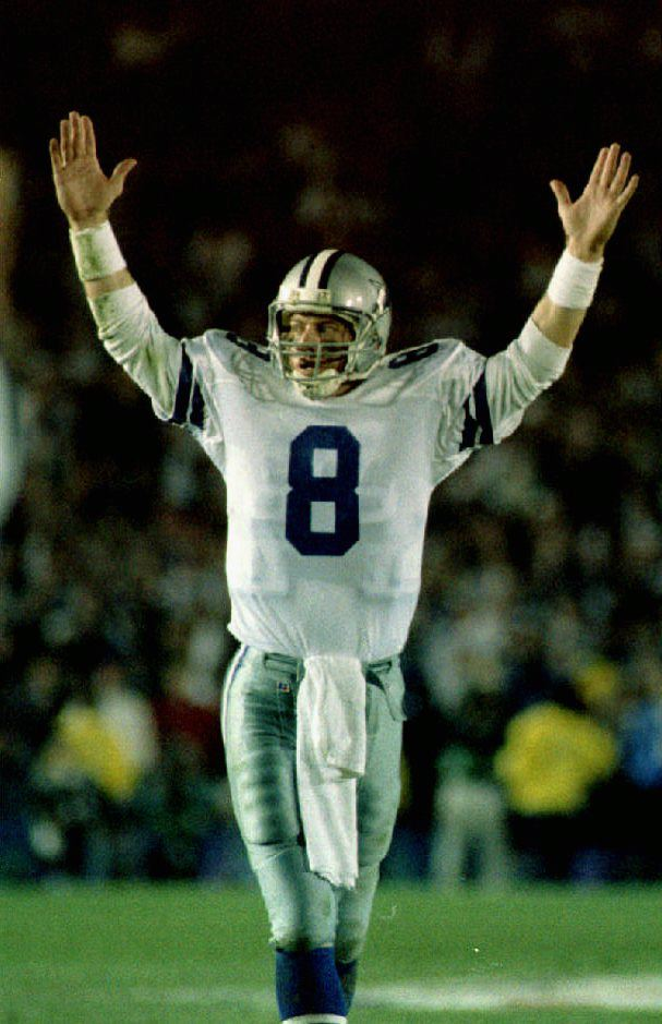 Dallas Cowboys quarterback Troy Aikman signals tou