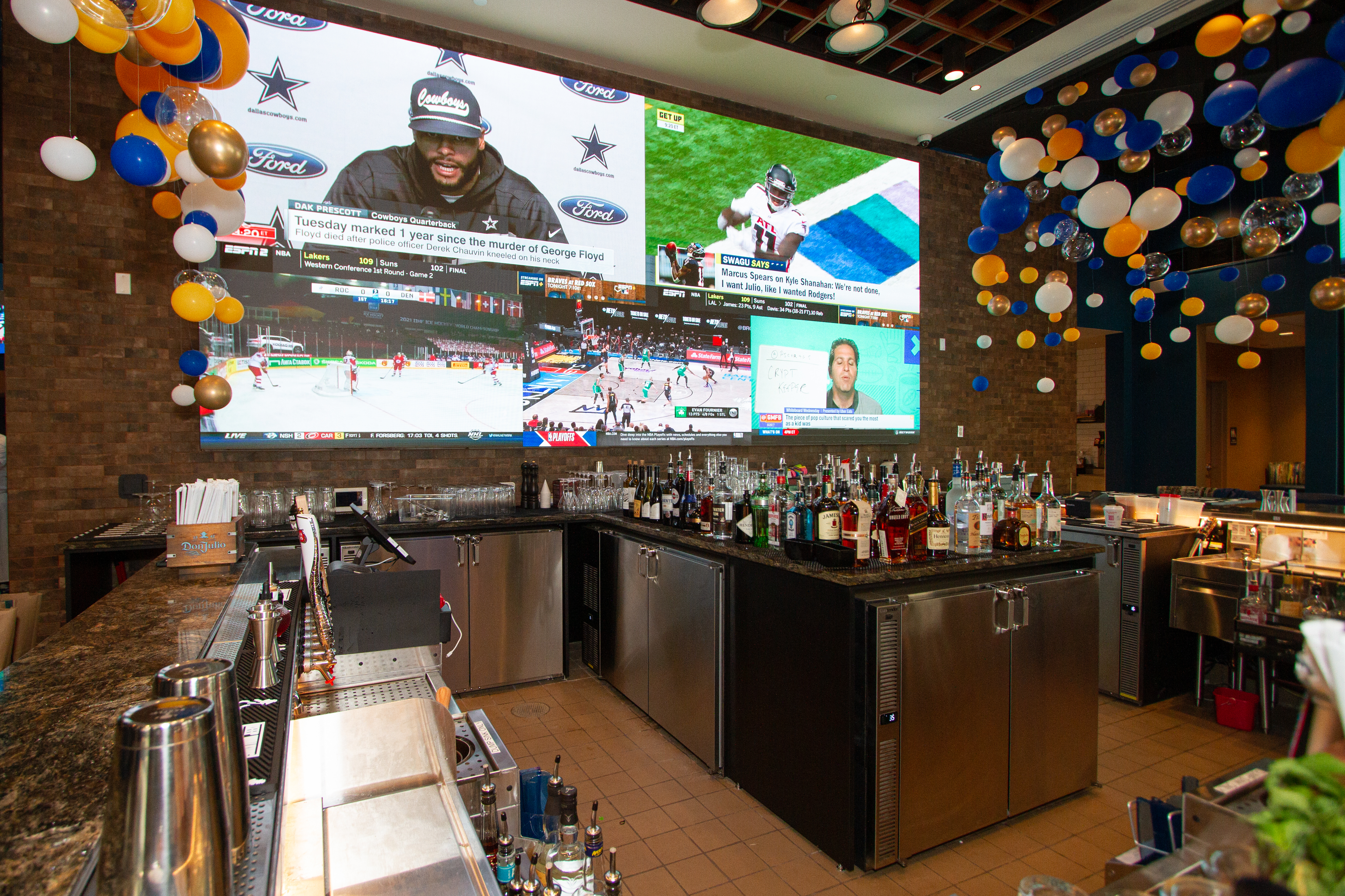 A huge screen behind the bar at William Hill Sportsbook shows off multiple sports at once